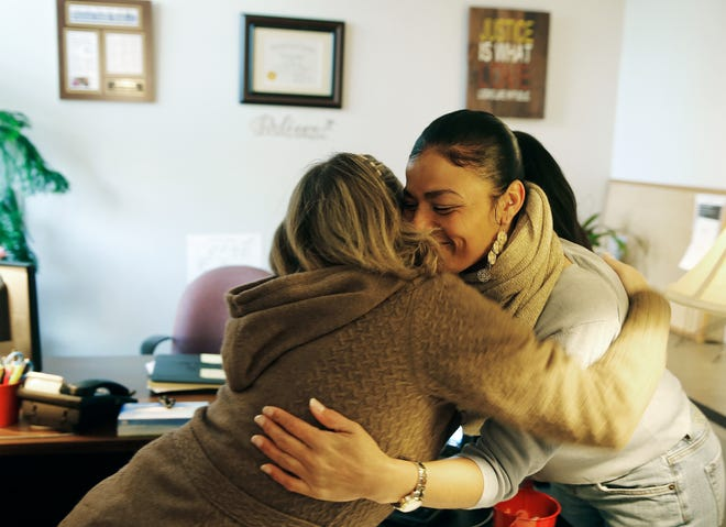 Tyra Patterson, right hugs co-worker Tiffany Smith at the Ohio Justice & Policy Center Friday, January 26, 2018. Patterson has worked as a paralegal and community outreach specialists since she was released from prison in December 2017.  Patterson spent 23 years incarcerated for murder and robbery, crimes she says she did not commit.