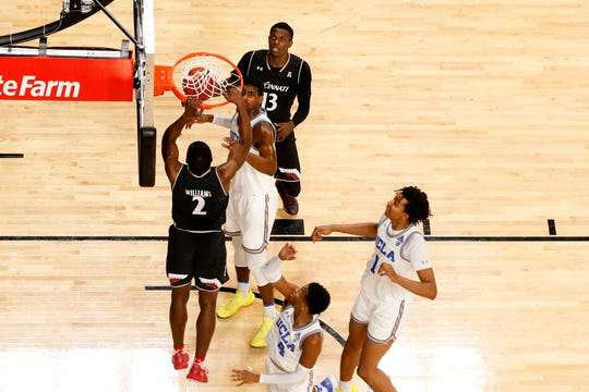 Cincinnati Bearcats guard Keith Williams (2) dunks in the second half of an NCAA college basketball game against the UCLA Bruins, Wednesday, Dec. 19, 2018, at Fifth Third Arena in Cincinnati. Cincinnati Bearcats won 93-64.