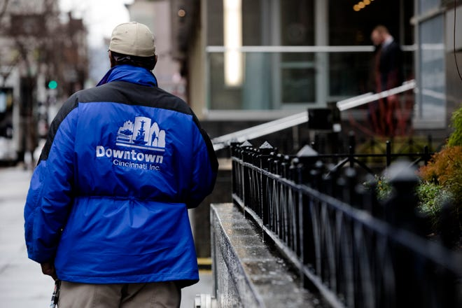 A Downtown City Inc. Ambassador stands near Fountain Square on Thursday, Dec. 20, 2018, in Downtown Cincinnati.