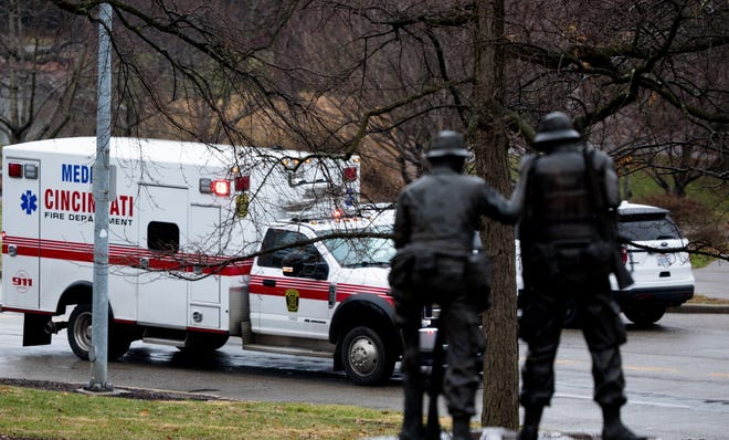 An ambulance escorted by police leaves the scene where a Cincinnati Police Officer at Eden Park, on Thursday, Dec. 20, 2018 in Cincinnati. Lakshmi Kode Sammarco, the Hamilton County Coroner, said the officer did not die from natural causes and that it was being investigated as to the whether or not it was an accident, suicide or homicide.