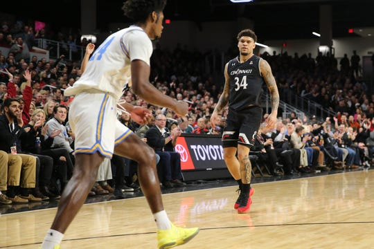 Cincinnati Bearcats guard Jarron Cumberland (34) stares at UCLA Bruins guard David Singleton (34) after making a 3-point shot in the first half of an NCAA college basketball game, Wednesday, Dec. 19, 2018, at Fifth Third Arena in Cincinnati.