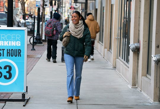 Tyra Patterson walks along Vine Street to work in January. Patterson has worked as a paralegal and community outreach specialists since she was released from prison in December 2017.