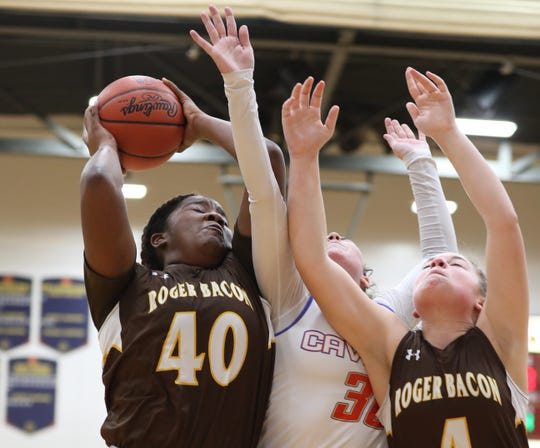 Roger Bacon  center Clarissa Craig (40) tries to shoot the ball over Purcell Marian forward Kara King.