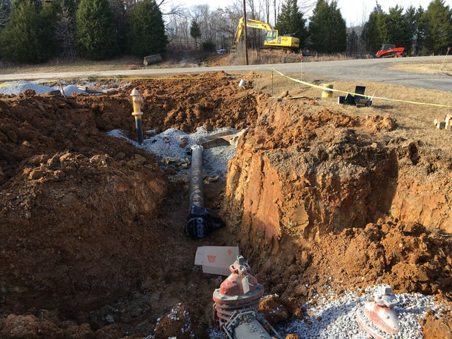 An eight-inch waterline from under Highway 149 awaits connection as construction crews on the other side of the road install pipe that will carry water from the City of Erin's treatment plant on the Cumberland River.