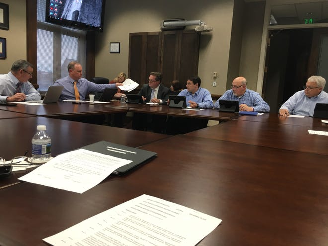 The Montgomery County Commission's Budget Committee, shown from left, includes County Mayor Jim Durrett, county Chief of Staff Jeff Truitt (handing off papers), and county commissioners John Gannon, Larry Rocconi, Rickey Ray and Charlie Keene.