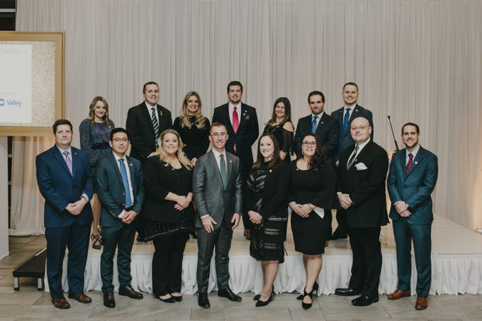 At the dinner gala celebrating the NJBankers Rising Stars of the banking industry, the 16 recipients included: (front row, left to right)Drew Bergstresser, Peapack-Gladstone Bank; Earl Jornadal, Kearny Bank; Erin Suckiel, NJBankers; Chris Rozewski, Peapack-Gladstone Bank; Kristen Patterson, ConnectOne Bank; Sheryl Shara, Investors Bank; Frank Lankey, Magyar Bank; and Patrick Rienzo, ConnectOne Bank;(back row, left to right): Delphine Marini, Unity Bank; Rob Surovich, Lakeland Bank; Kimberly Doll, Bank of America Merrill Lynch; Max Custer, Lakeland Bank; Katie Meyers, Manasquan Bank; Colin Bliss, Valley; and Anthony Niciejewski, Spencer Savings Bank. Not pictured: Mayra Rinaldi, Columbia Bank.