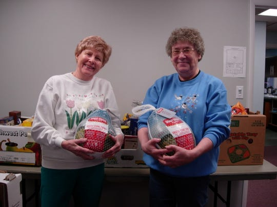 Each Thanksgiving and Christmas Wegmans provides turkeys for needy families in Somerset County. The turkeys supplement the non-perishable items collected at the Bridgewater Senior Center through the donations of attendees. Jan Sopko and Barbara Albani hold two of the turkeys to be delivered in time for Christmas.