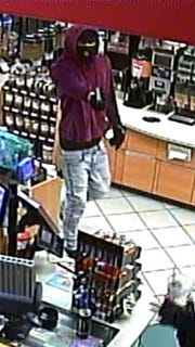 The suspect in the Edison robbery  is described as a male of slight build wearing light-colored pants, possibly jeans, a maroon colored hooded sweatshirt, mask and gloves.
