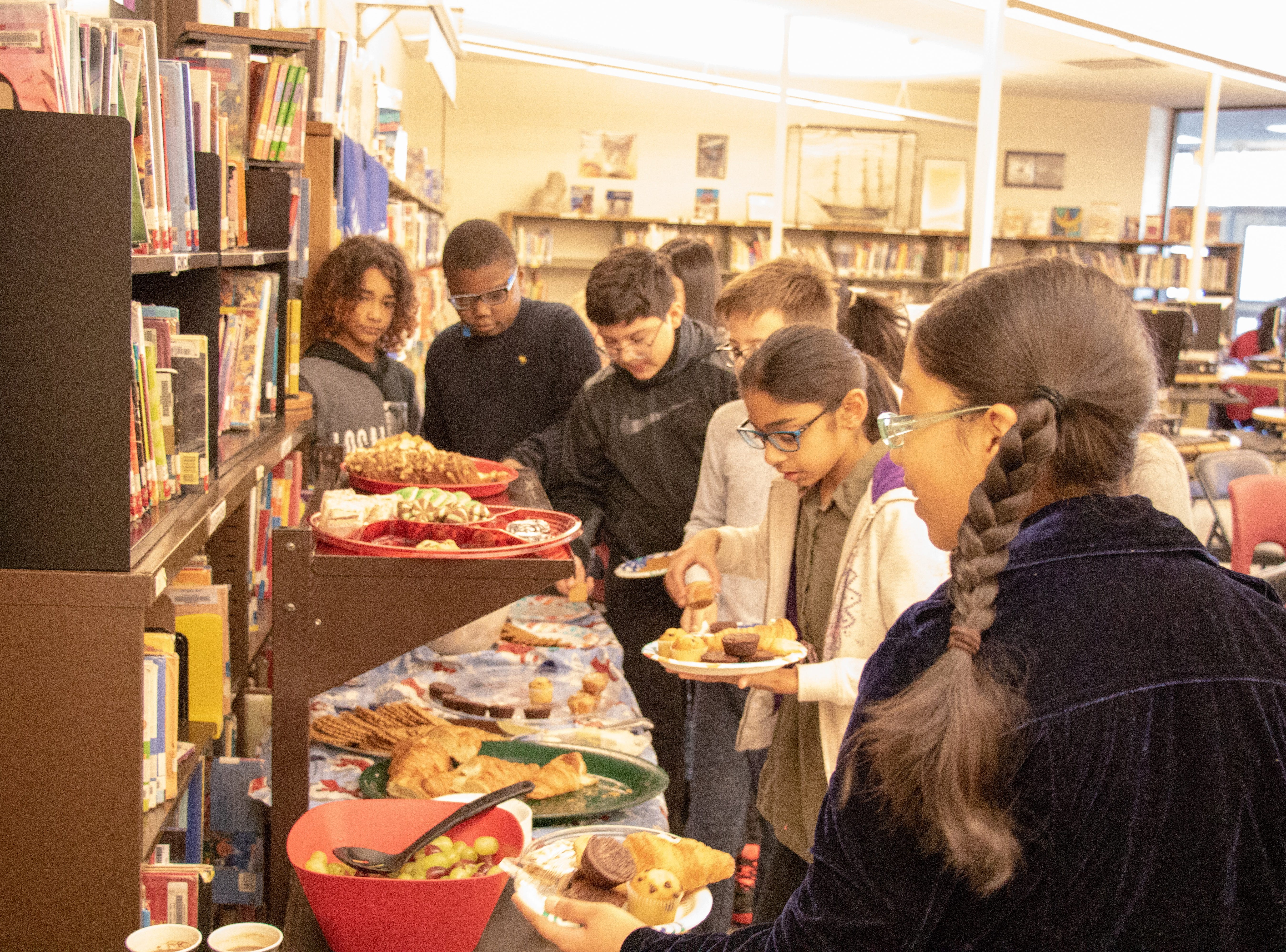 Students in the Honors Language Arts program at the Arbor School in Piscataway hosted Tea and Talk with local senior citizens on Dec. 19 for their Oral History project.