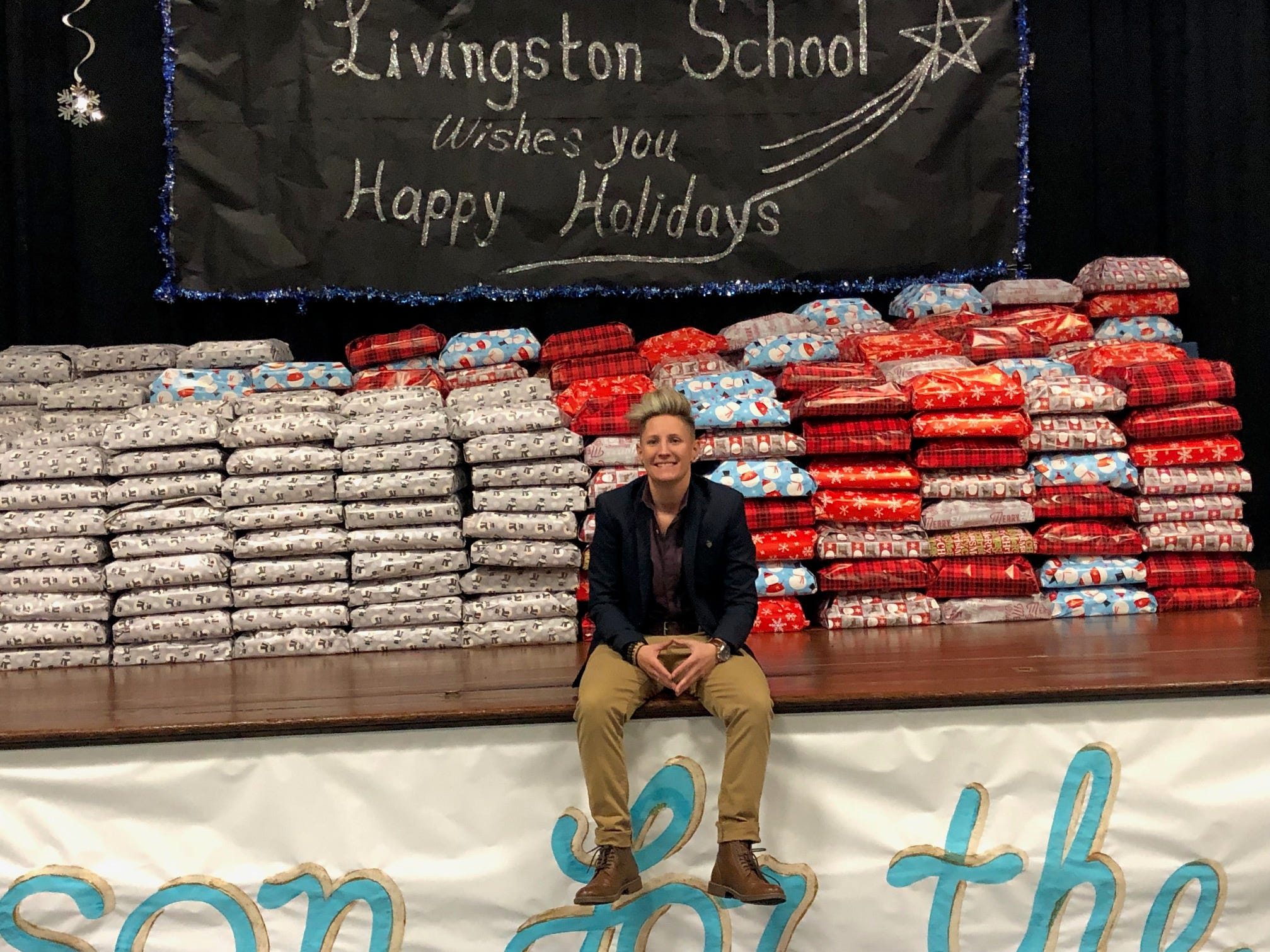 """A Santa Claus of sorts, New Brunswick teacher Jennifer Olawski is ensuring that every single of of her more than 450 students will receive a gift this holiday season. Continuing a program she began in her former school, Olawski, a physical education and health teacher at Livingston Elementary School, created a GoFundMe campaign to raise funds for gifts for the children. This year's effort saw more than $10,000 in donations and the help of many school """"elves."""""""