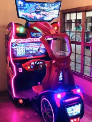A racing car video game at Mac Shack in Valley West Mall.