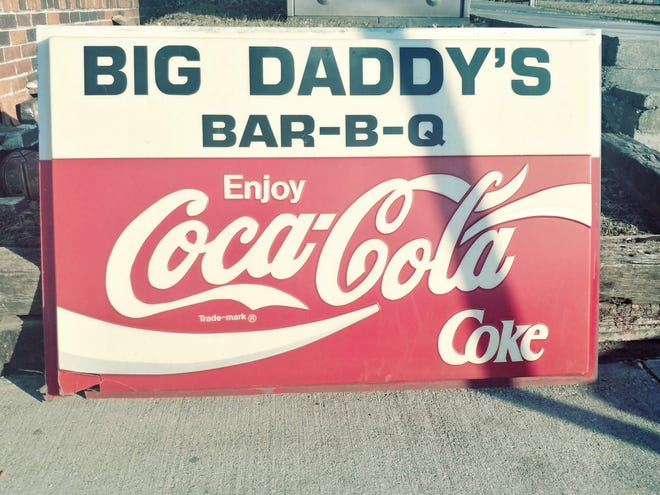 Two of the signs that hung outside of Big Daddy's Bar-B-Q in Des Moines for more than 20 years are being sold in an eBay auction.