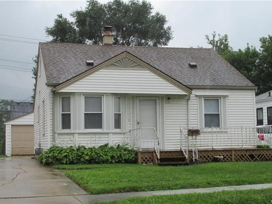 This 2-bedroom house on Chestnut in Hazel Park has dark hardwood floors, a detached garage and updated bathroom.