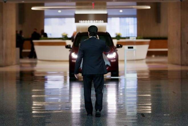 Unifor National President Jerry Dias arrives at the Renaissance Center in Detroit on Thursday, Dec., 20, 2018, to meet with General Motors executives about the future of the Oshawa assembly plant in Canada.