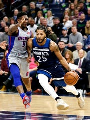 Minnesota Timberwolves guard Derrick Rose drives on Detroit Pistons guard Langston Galloway in the first quarter Wednesday, Dec. 19, 2018, in Minneapolis.