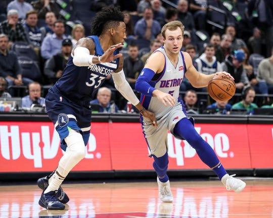 Detroit Pistons guard Luke Kennard drives past Minnesota Timberwolves forward Robert Covington in the first quarter Wednesday, Dec. 19, 2018, in Minneapolis.