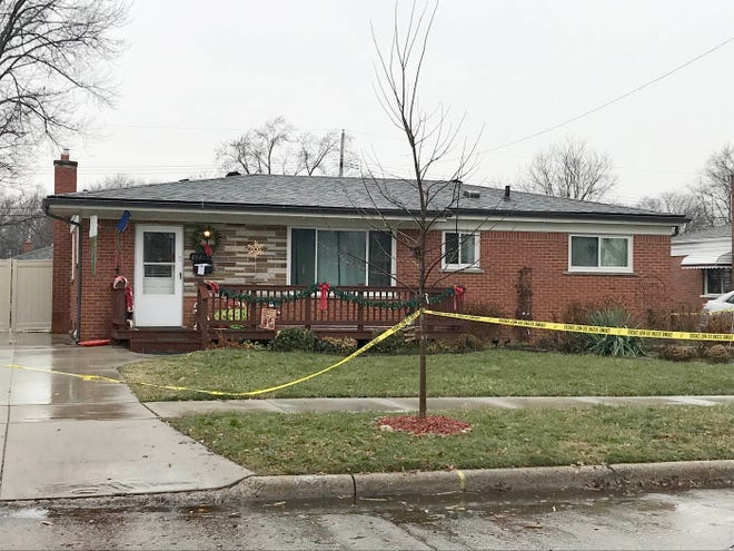 Police tape surrounds the house on Masch Avenue in Warren on Thursday, Dec. 20,  2018 where the body of a 68-year-old woman was found stuffed in a trash bin in the detached garage. The woman's 23-year-old grandson was arrested in Toledo but reportedly was killed at the police station when he grabbed an officer's gun.