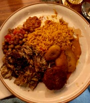 A plate from a recent YumVillage pop-up event with jerk chicken, rice, chick peas, plantains and a black bean fritter.