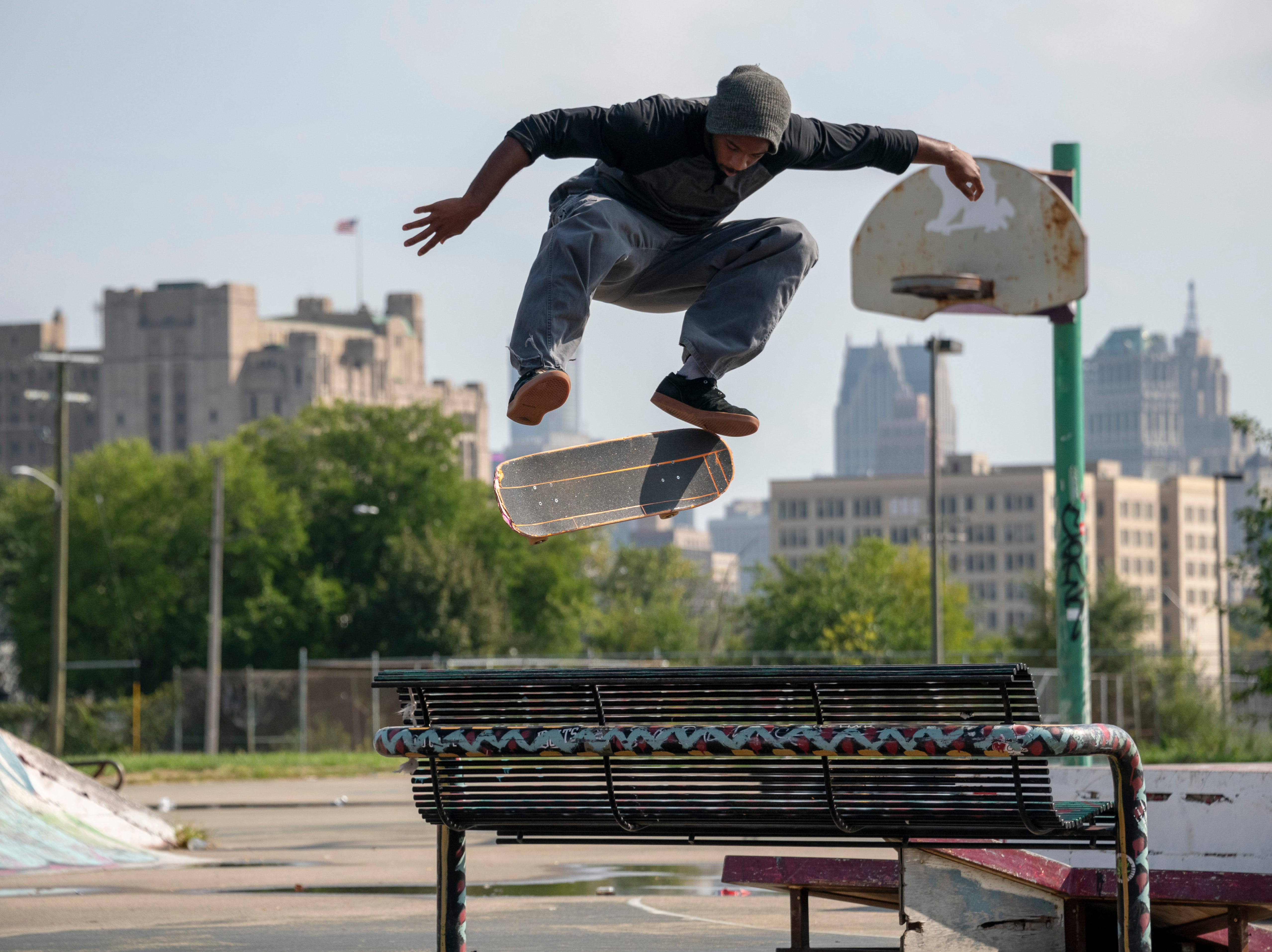 Keviyan Richardson of Detroit jumps over a bench at the Wig skatepark in Detroit, October 3, 2018.