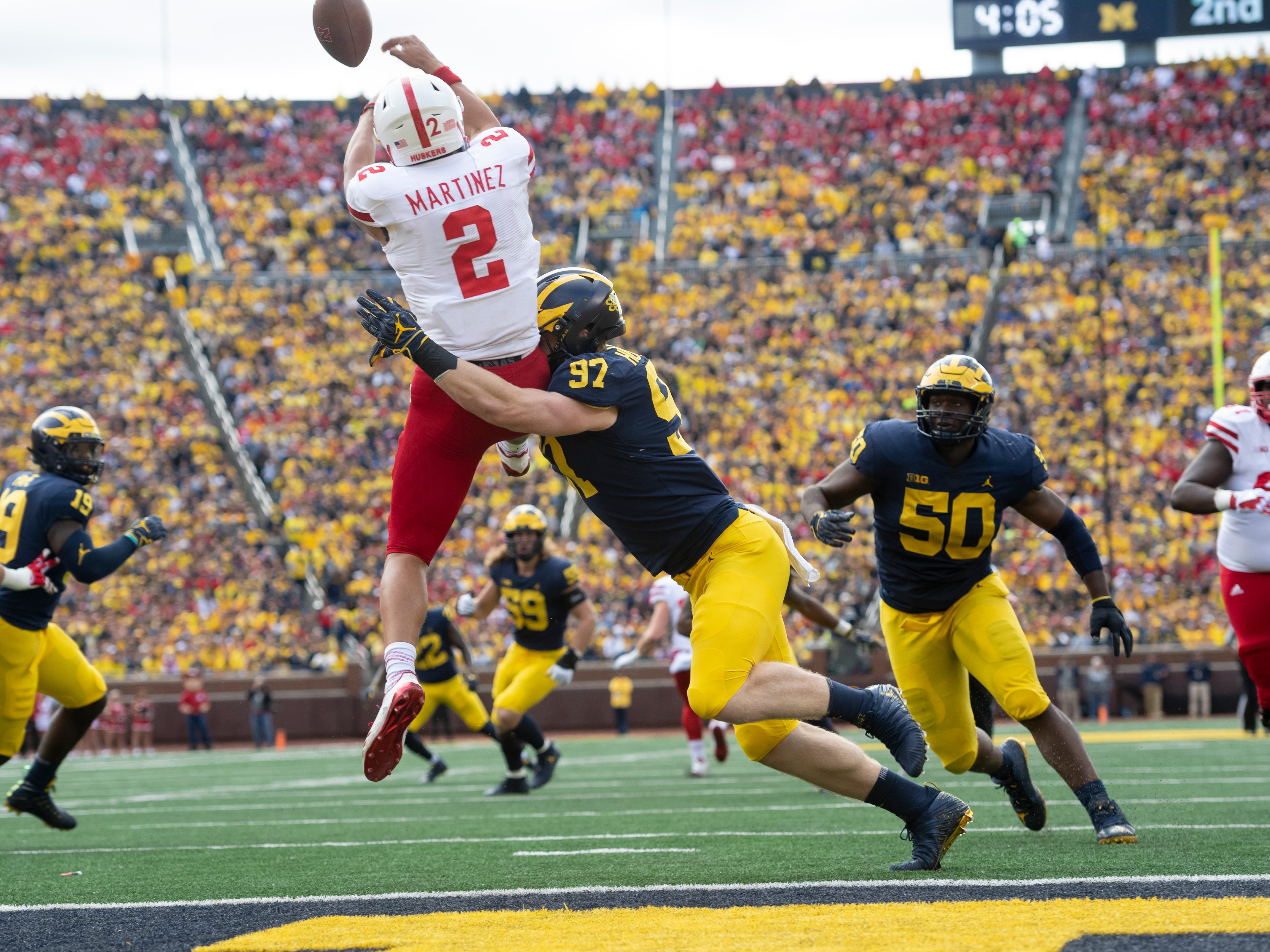 Nebraska quarterback Adrian Martinez batts down a deflected pass that came back at him in front of Michigan defensive lineman Aidan Hutchinson in the second quarter.  The play was ruled a safety. Michigan defeated Nebraska 56-10 at Michigan Stadium, in Ann Arbor on September 22, 2018. The Wolverines won ten in a row between season opening (at Notre Dame) and ending (at Ohio State) losses. The 7th-ranked Wolverines (10-2) play Florida in the Peach Bowl on Dec. 29th.