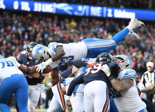 Lions running back Kerryon Johnson leaps over the top for a touchdown against the Chicago Bears at Soldier Field in Chicago on Nov. 11, 2018. The Lions lost, 34-22.