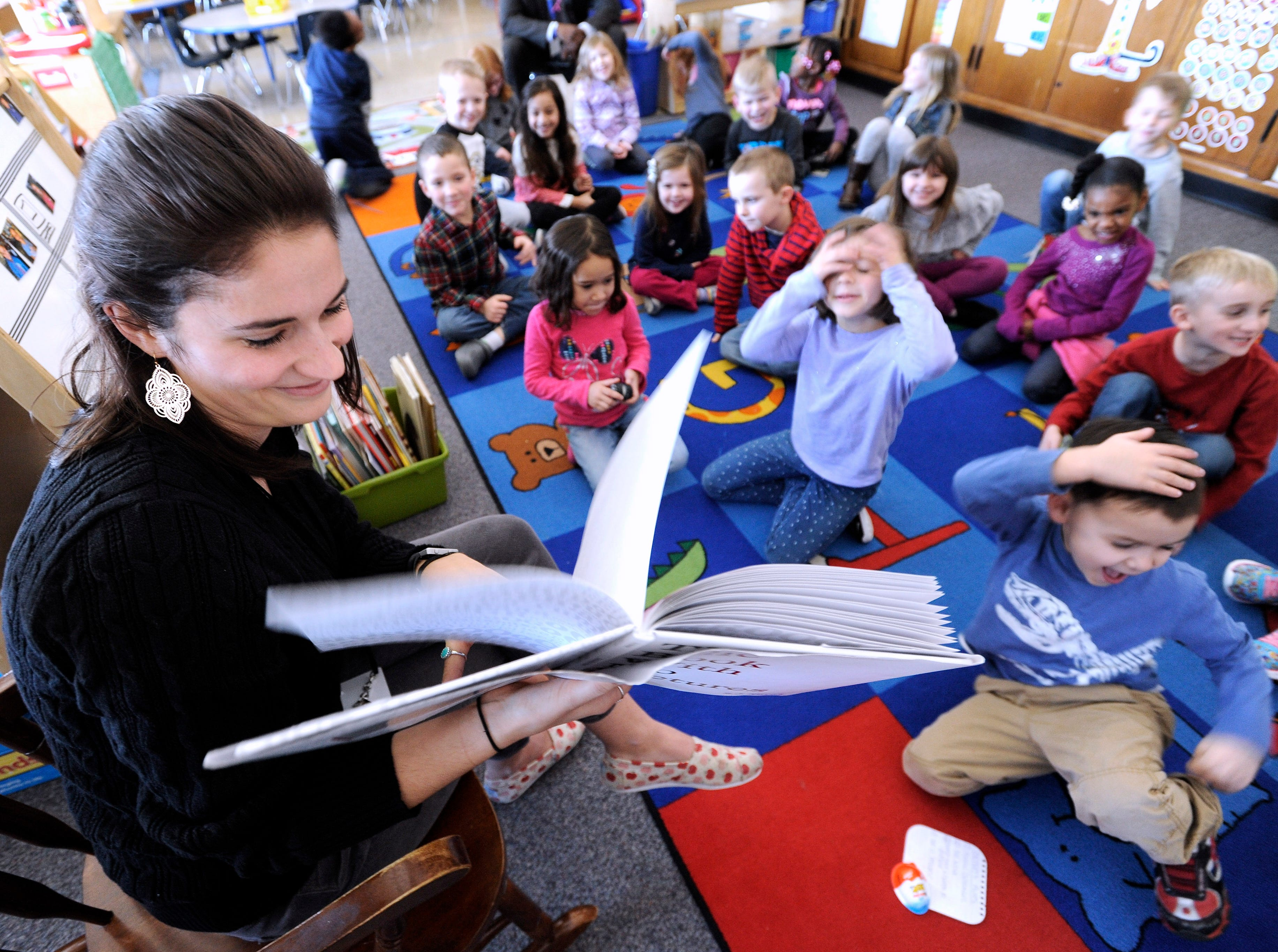 "Long-term substitute teacher Samantha DeSandre, 24, of Eastpointe, reads, ""The Book With No Pictures,"" by B.J. Novak, to her kindergarteners at Mason Elementary School in Grosse Pointe Woods,  January 4, 2018. A bill loosening requirements for substitute teachers in Michigan was signed into law in June."