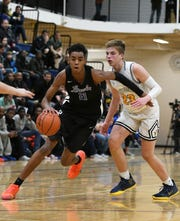 Lincoln High School freshman Emoni Bates, drives past Saline High School's Griffin Yaklich during the second quarter of Lincoln's 70-39 win over Saline.