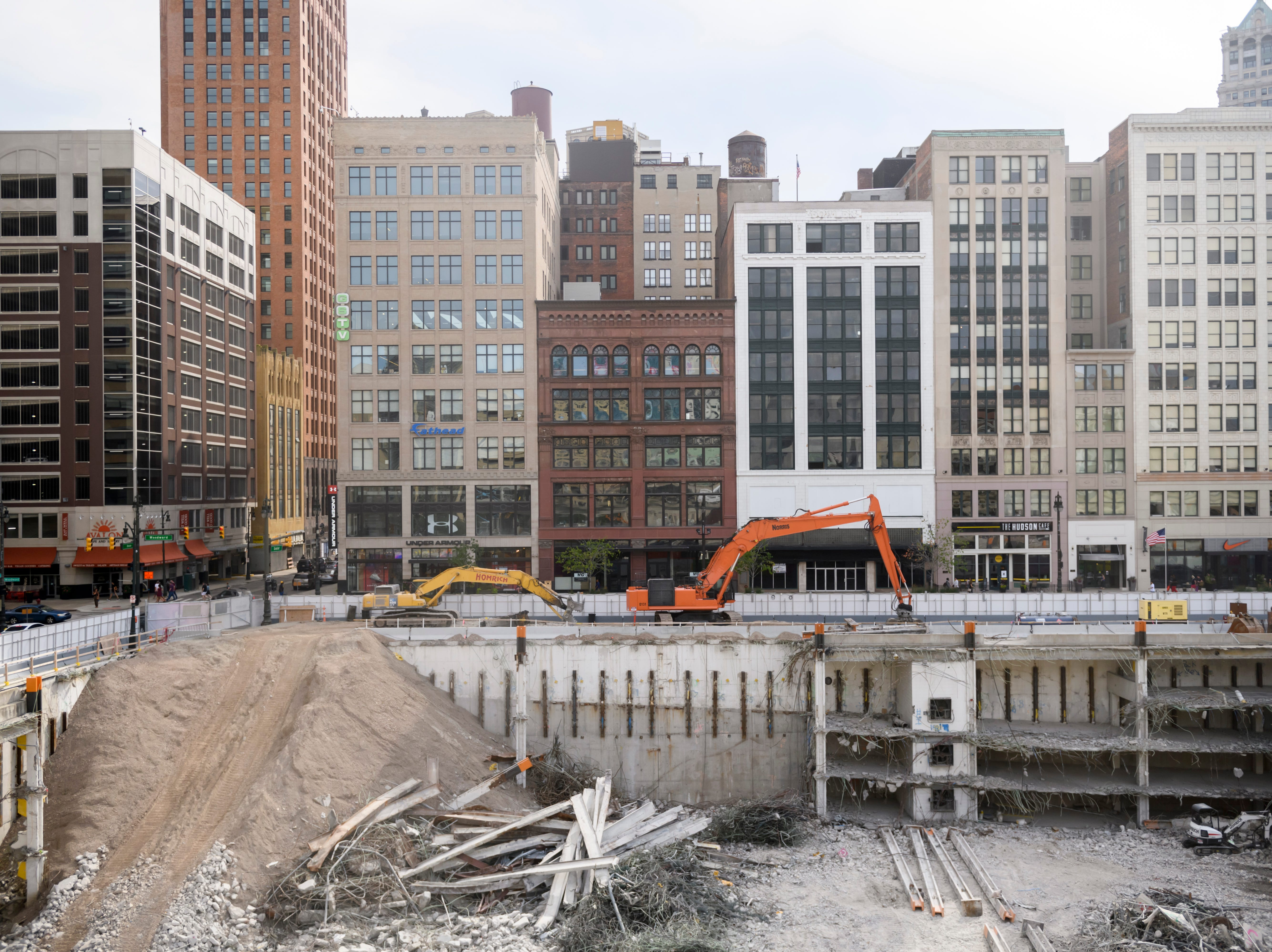 Excavation crews work on clearing out the remains of the former Hudson's building on Woodward Avenue in Detroit on July 12, 2018.