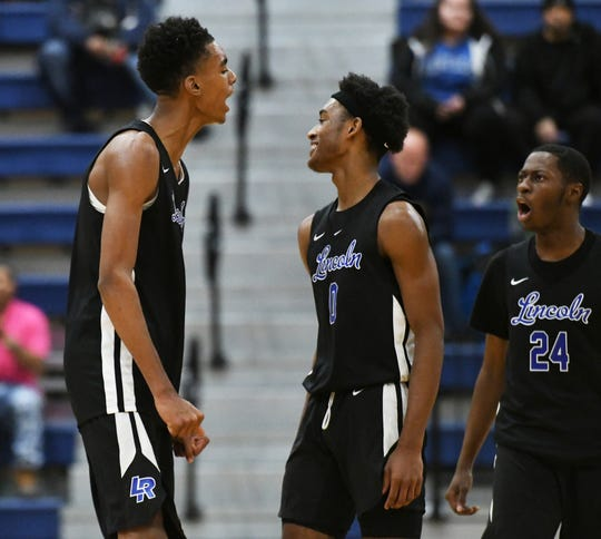Lincoln High School freshman Emoni Bates, left, shows a little attitude after throwing down a windmill dunk in the fourth quarter.