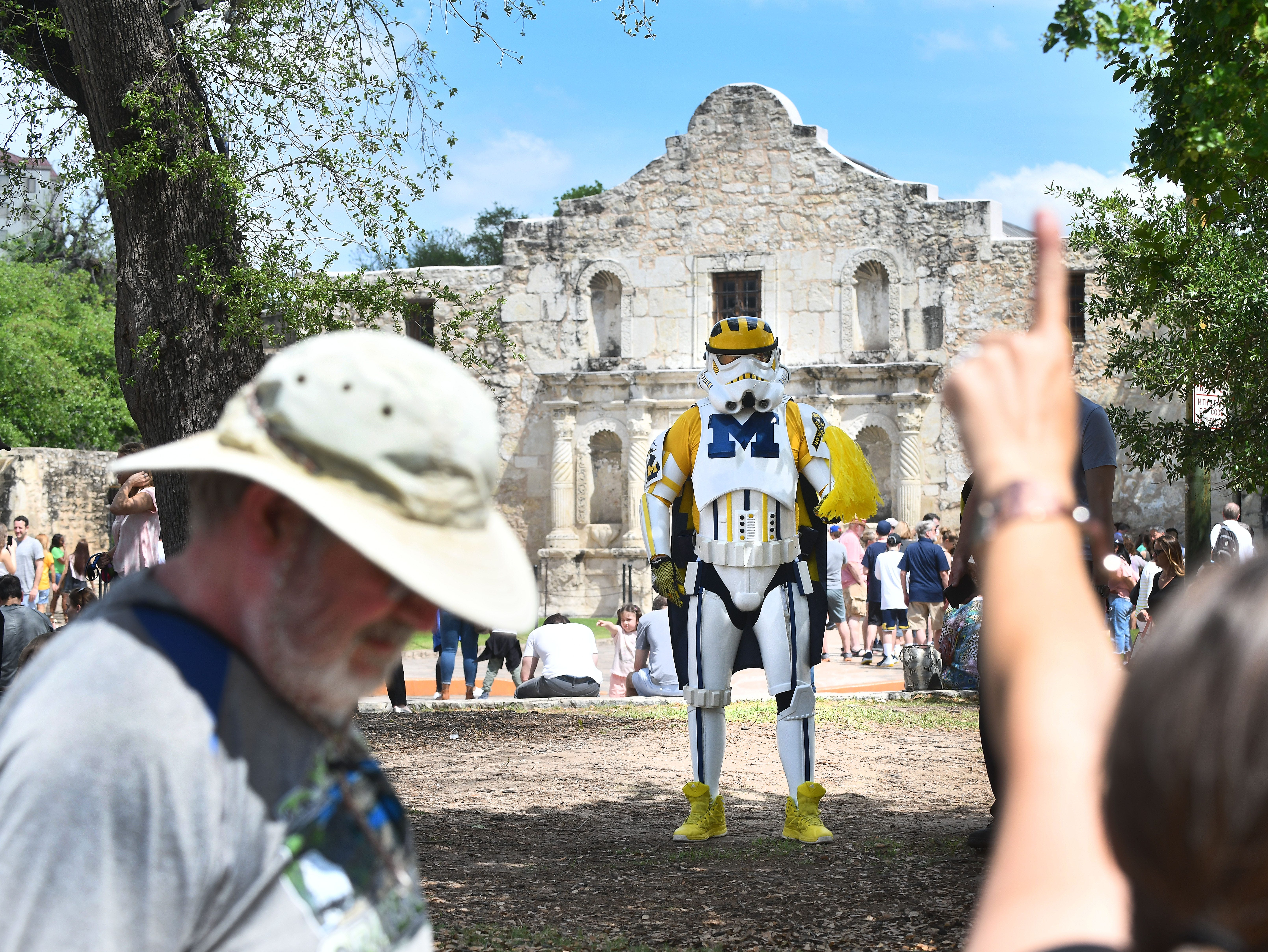 Jon Leopold of the 501st Legion visits the Alamo, to the delight of Michigan fans, in San Antonio, Texas on April 1, 2018.  The fans were in town to watch Michigan play in the NCAA basketball finals.