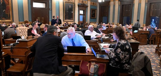 "Sen. Jim Stamas, R-Midland, left, confers with Sen. Rick Jones, R-Grand Ledge, during a busy evening Thursday as the senate considers a fIurry of bills on what should be the last day of the ""lame duck"" session."