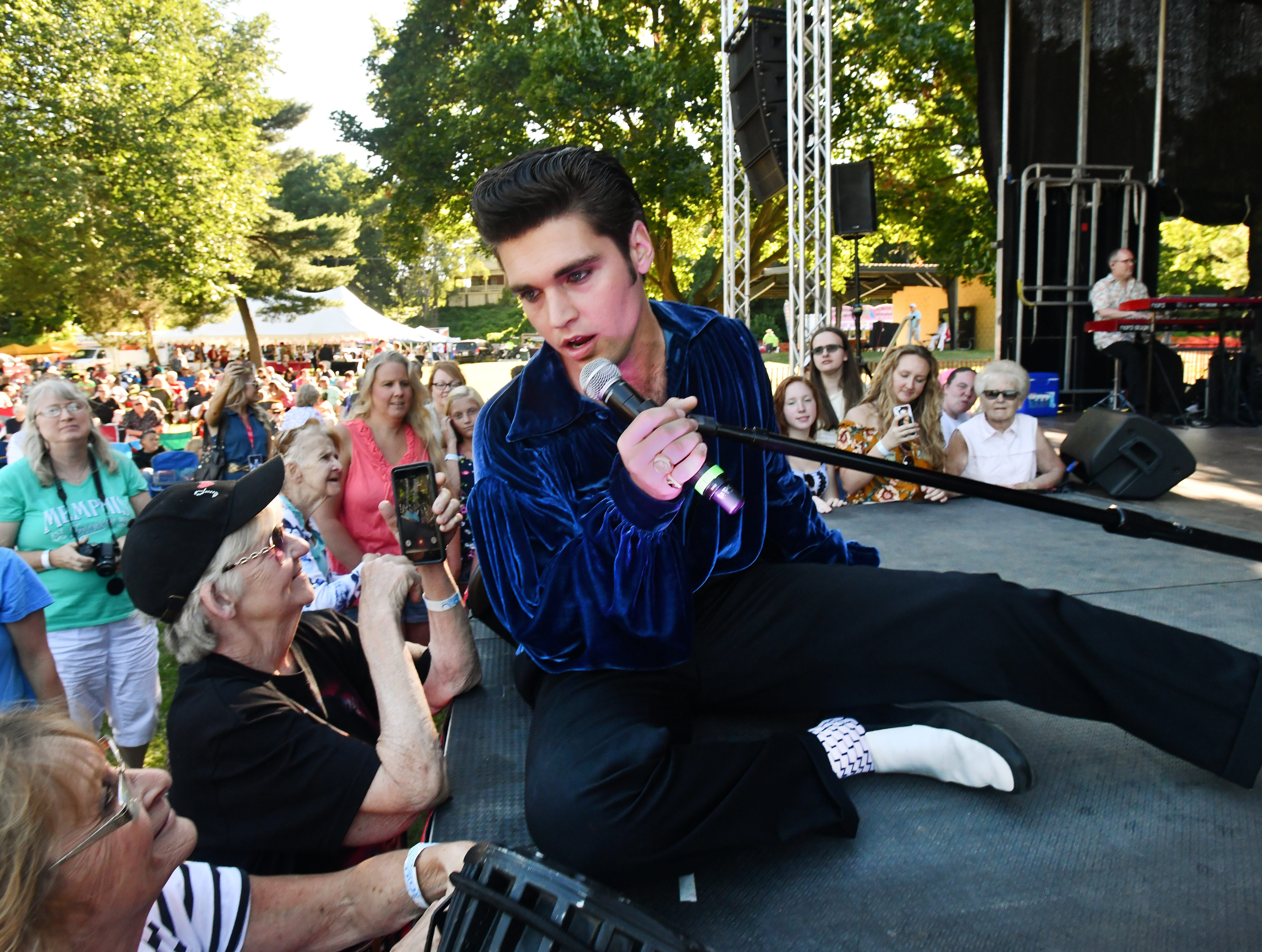 Elvis impersonator Jake Slater croons to the front row during his set at the Michigan Elvisfest at Depot Town in Ypsilanti on July 6, 2018.