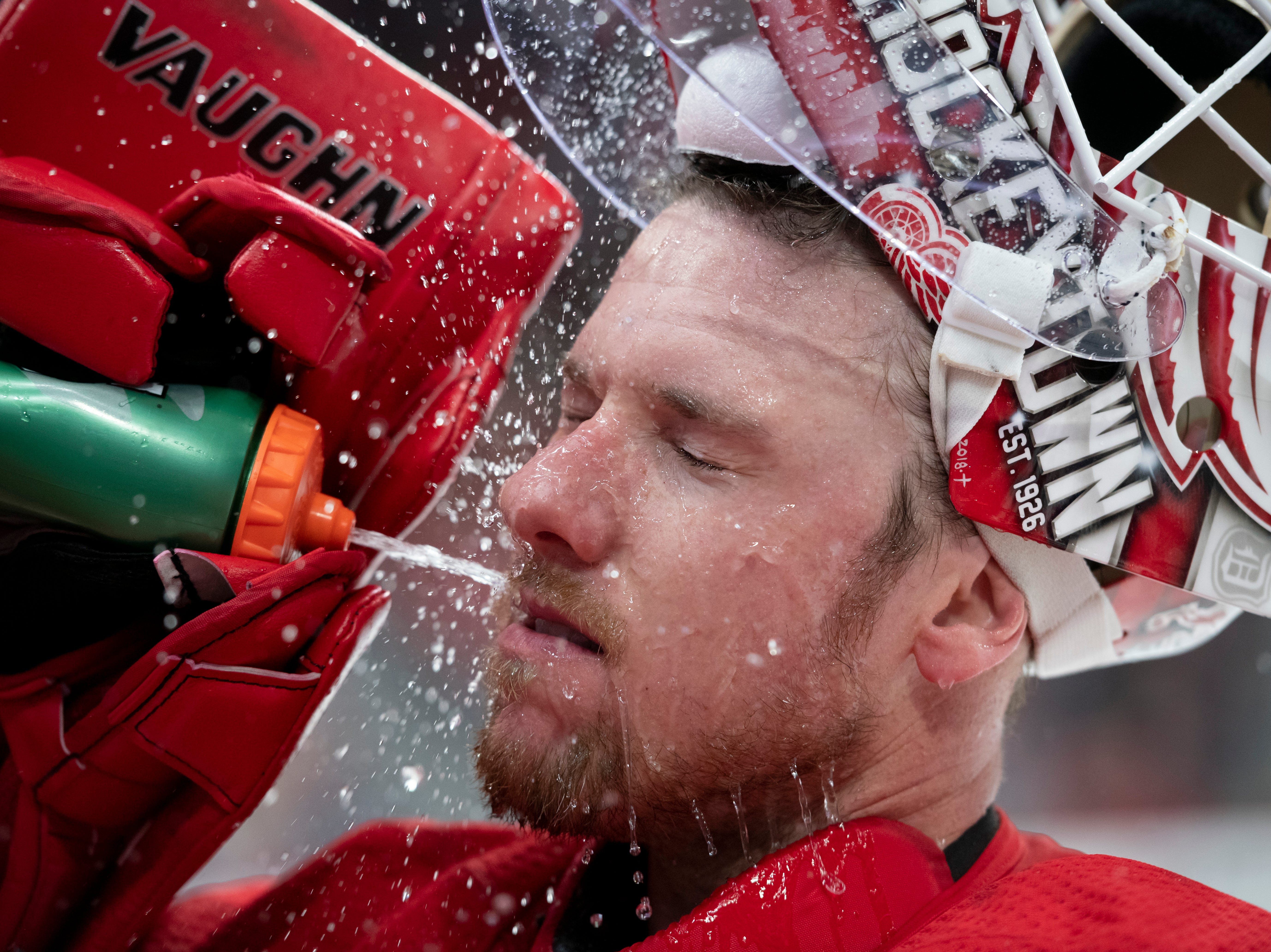 Detroit goaltender Jimmy Howard refreshes himself with a splash of water during a game against the Toronto Maple Leafs at Little Caesars Arena, in Detroit, October 11, 2018.
