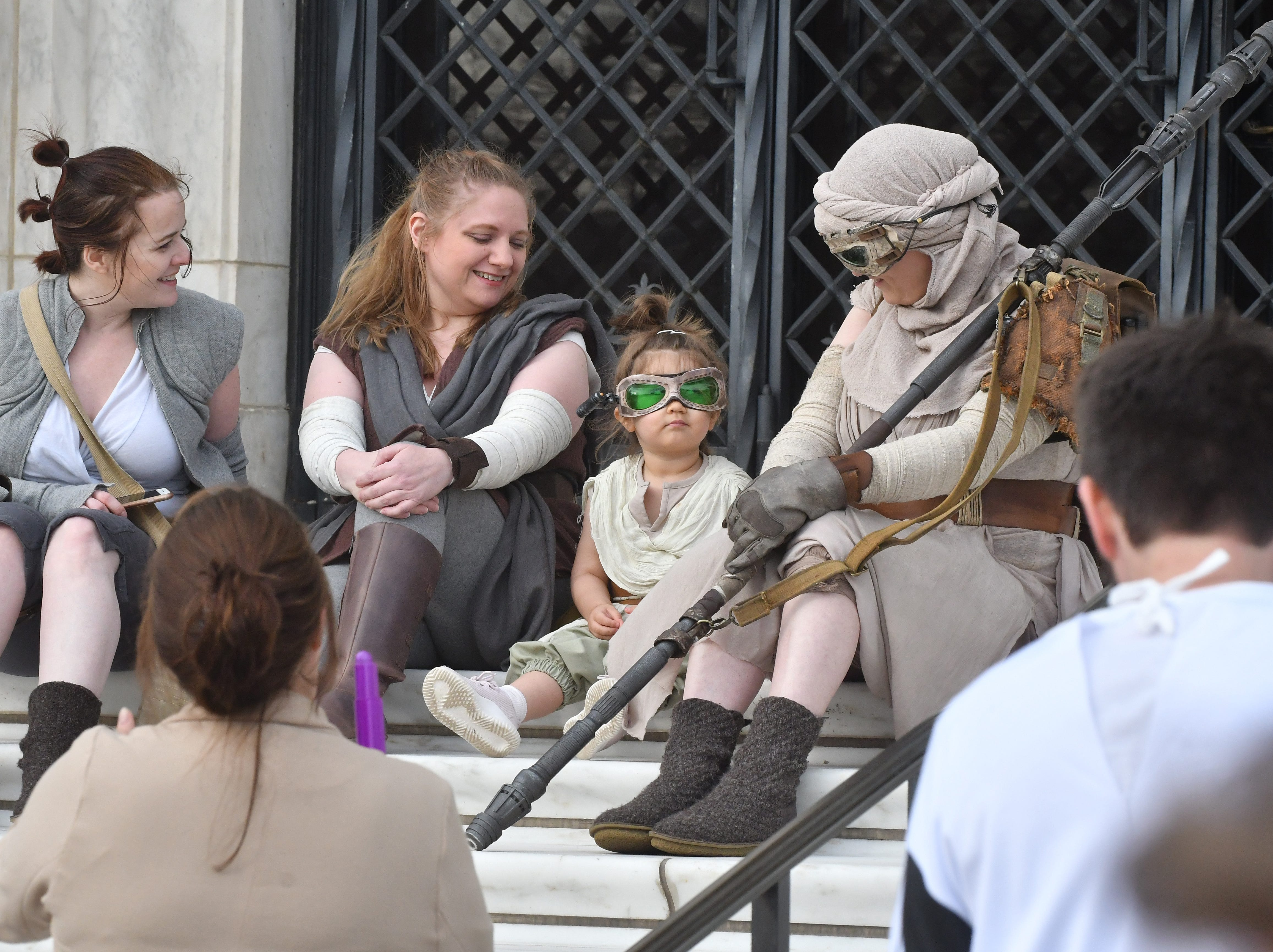 A gaggle of 'Jedi Rey' characters chat on the steps of the Detroit Institute of Arts on May 4 (May the Fourth be with you, get it?). From left, Anna Rossmann, Martha Green, Molly Malangone, 3, and Kristen Jones accepted the DIA's invitation for a fan photo shoot in advance of the exhibit 'Star Wars and The Power of Costume.'