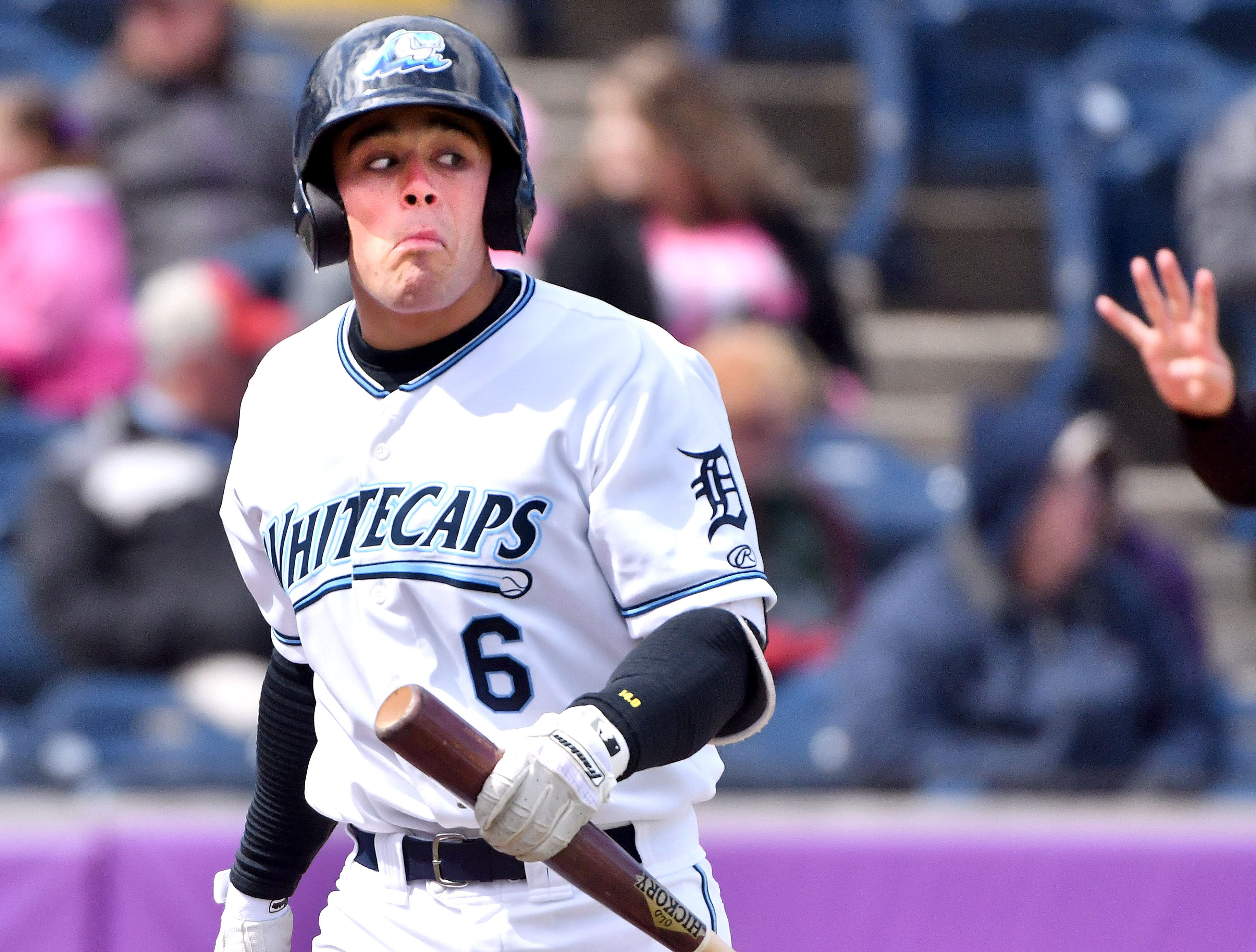 Catcher Brady Policelli makes faces after the umpire called him out on strikes as the West Michigan Whitecaps beat the Great Lakes Loons, 10-4, on April 10, 2018 at Fifth Third Bank ballpark in Grand Rapids.