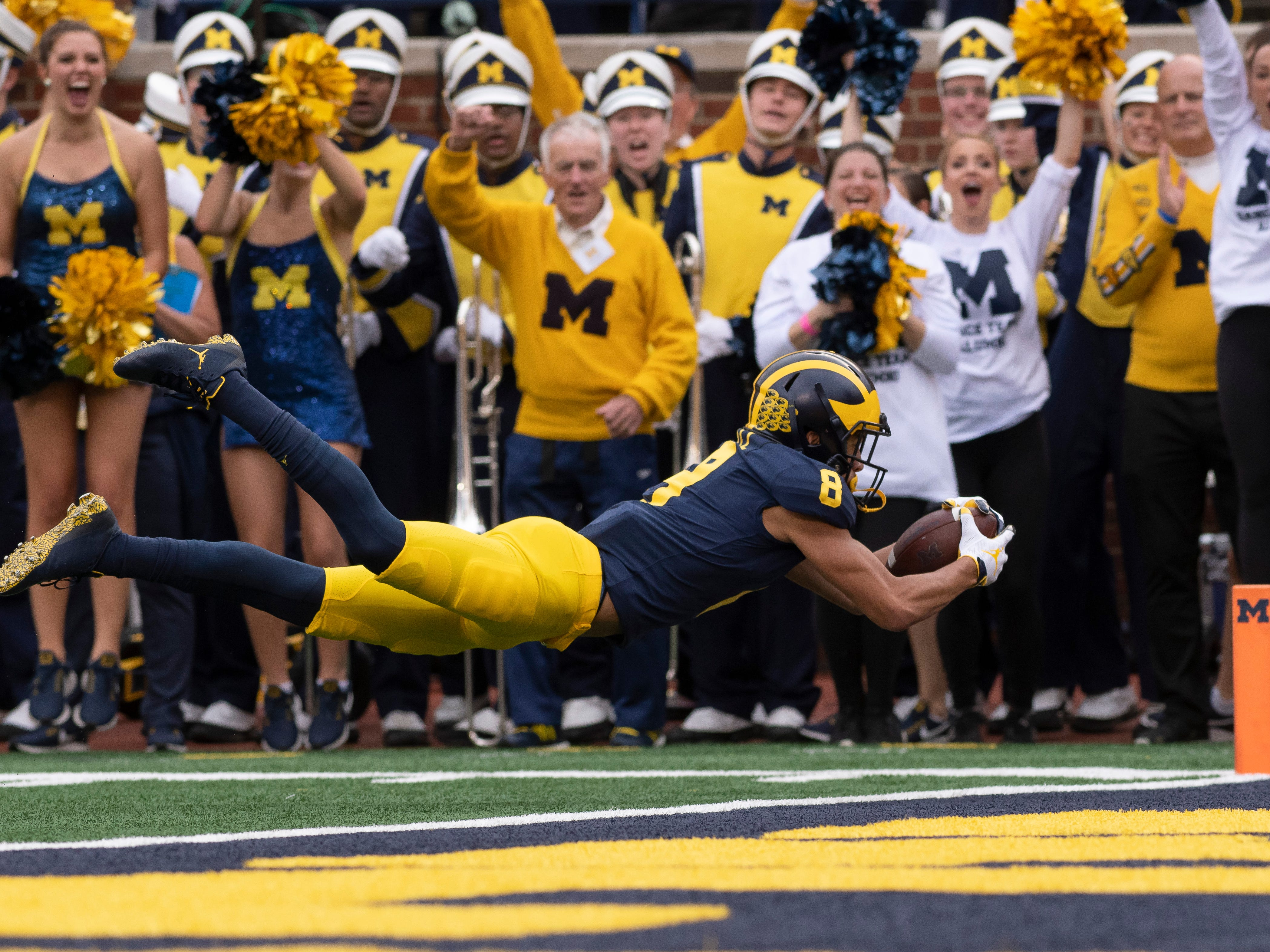 Michigan wide receiver Ronnie Bell dives into the end zone for a touchdown against Maryland to the delight of the homecoming crowd at Michigan Stadium, in Ann Arbor, October 6, 2018. Michigan won the game 42-21.