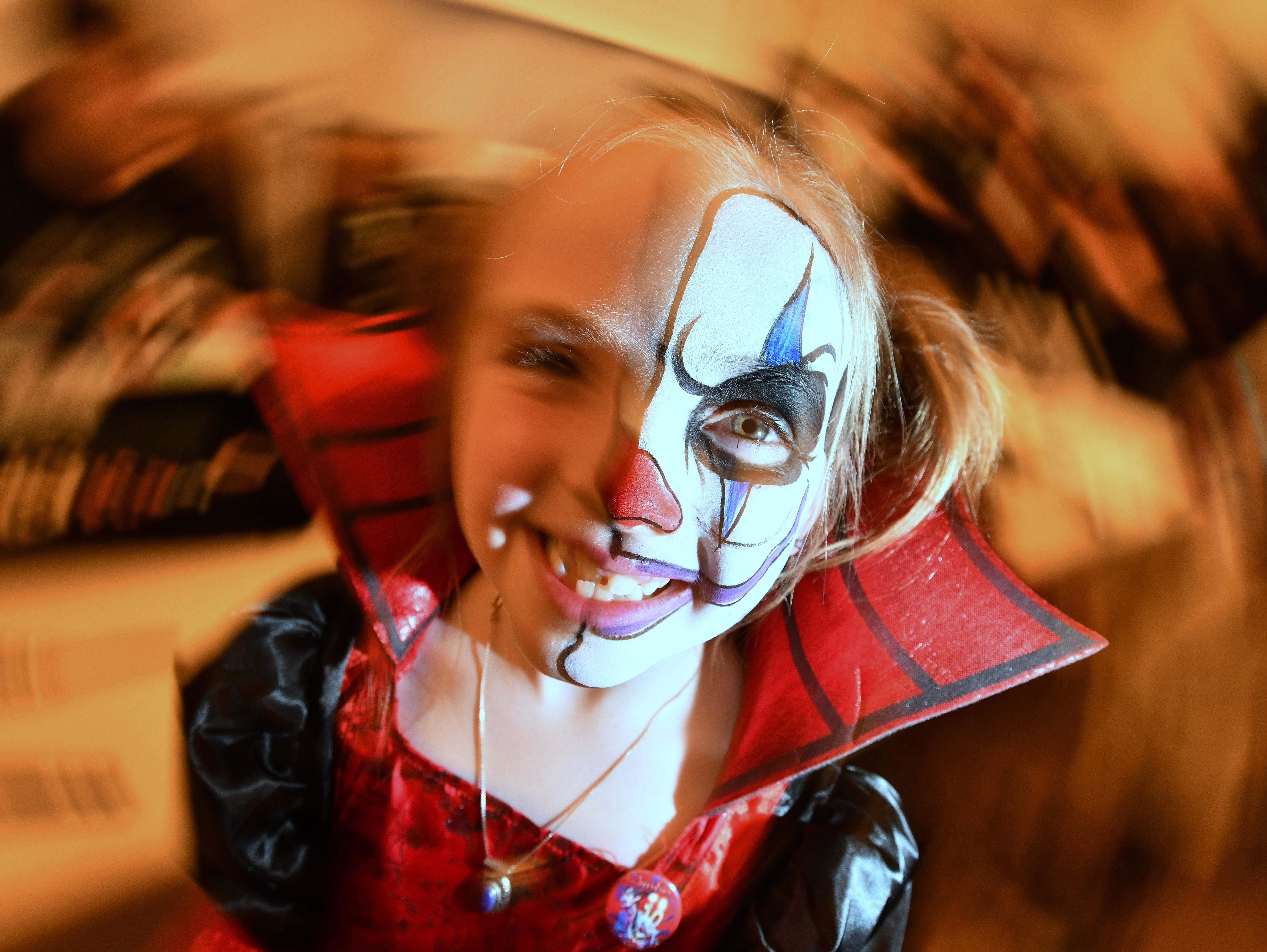 Alexis Grandy, 7 splits her time as a little bit adorable, a little bit scary during her visit to the Motor City Nightmares Horror Expo and Film Festival at the Novi Sheraton in Novi on April 27, 2018.