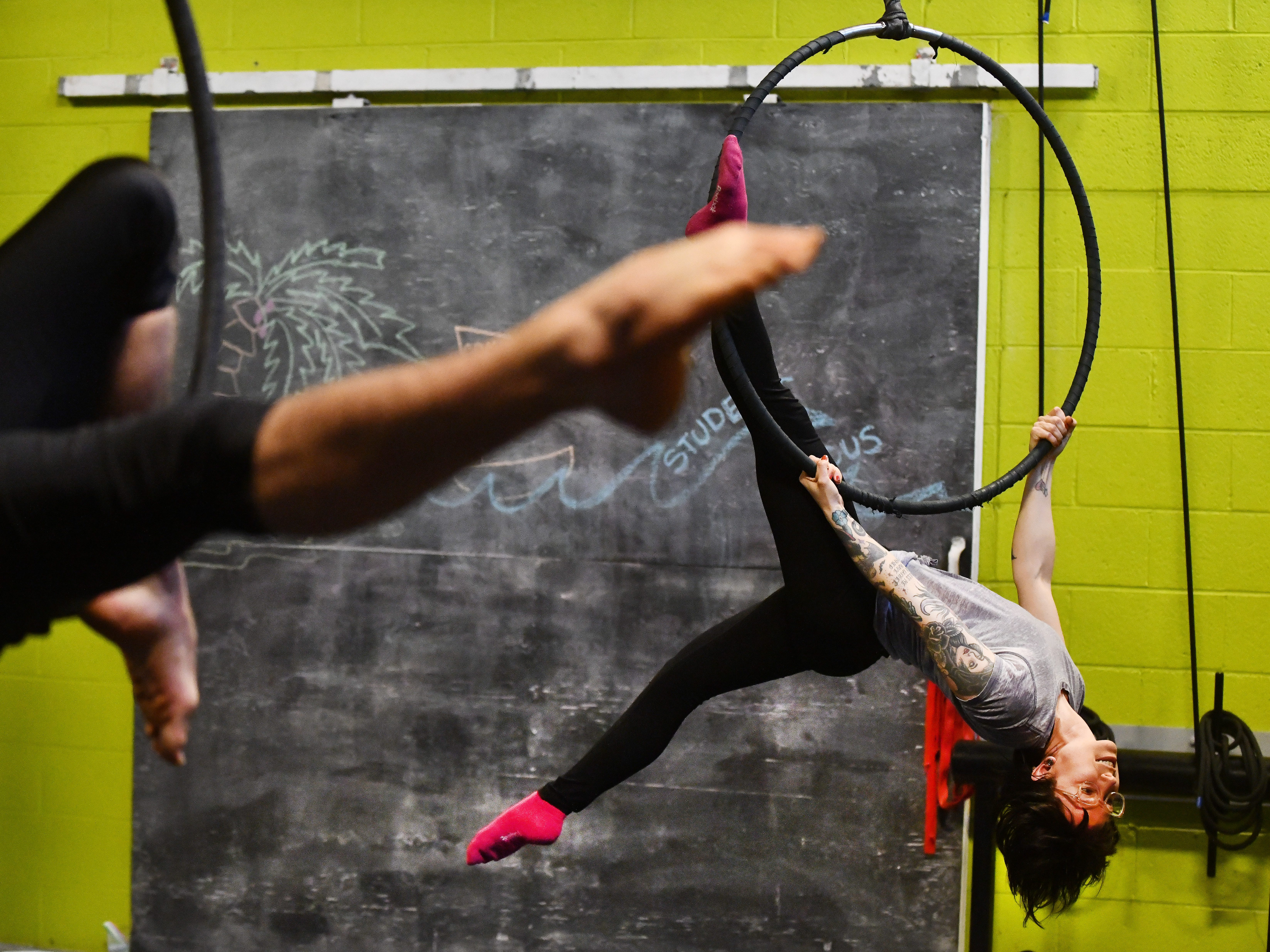 Instructor Sara Duhaime demonstrates a position during a class at the Detroit Flyhouse Circus School in Detroit on April 4, 2018.