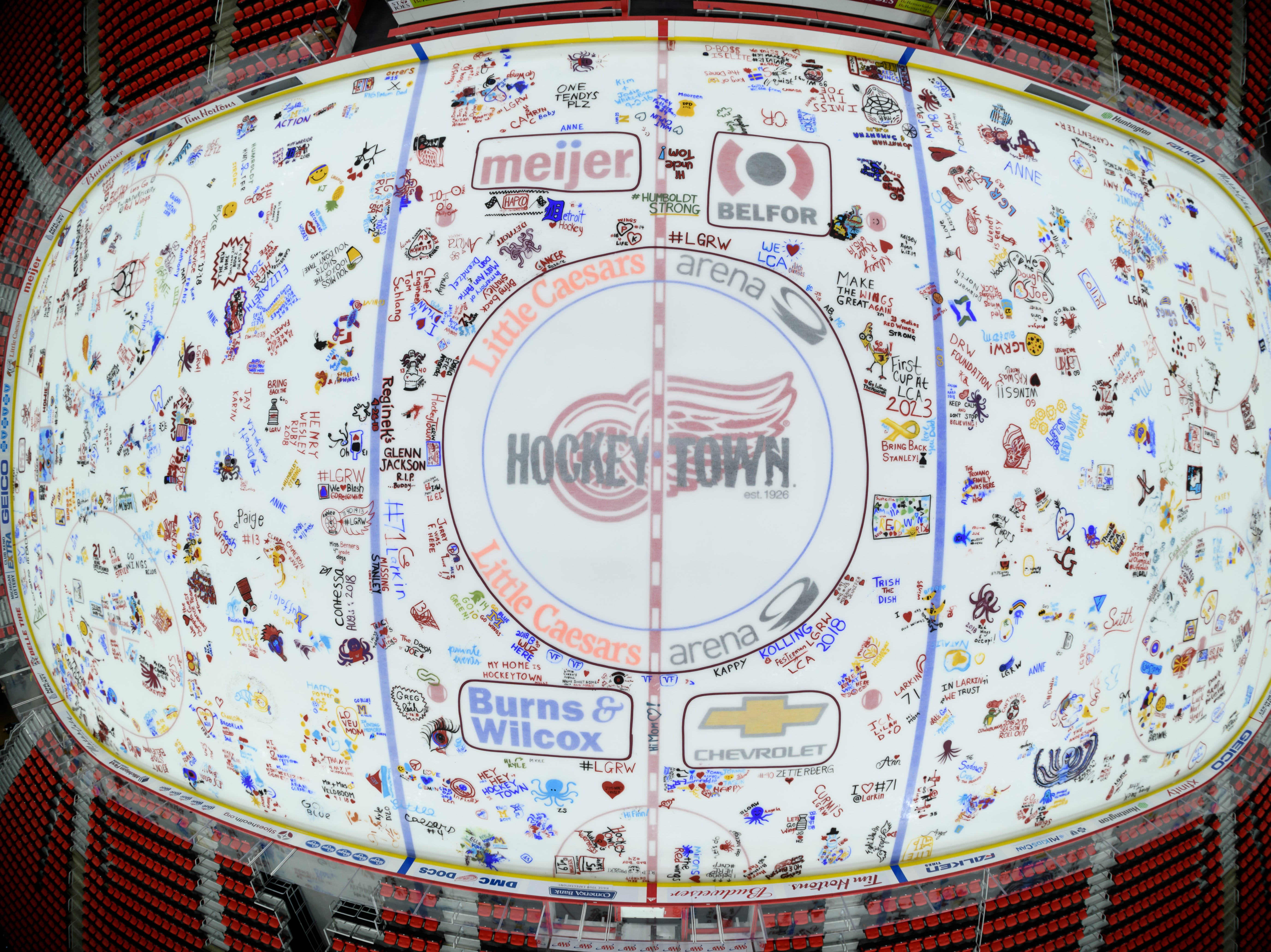 "After making a donation to benefit the Detroit Red Wings Foundation, fans were permitted to paint personalized messages on a section of the ice during a ""Paint the Ice"" event at Little Caesars Arena in Detroit on April 26, 2018."