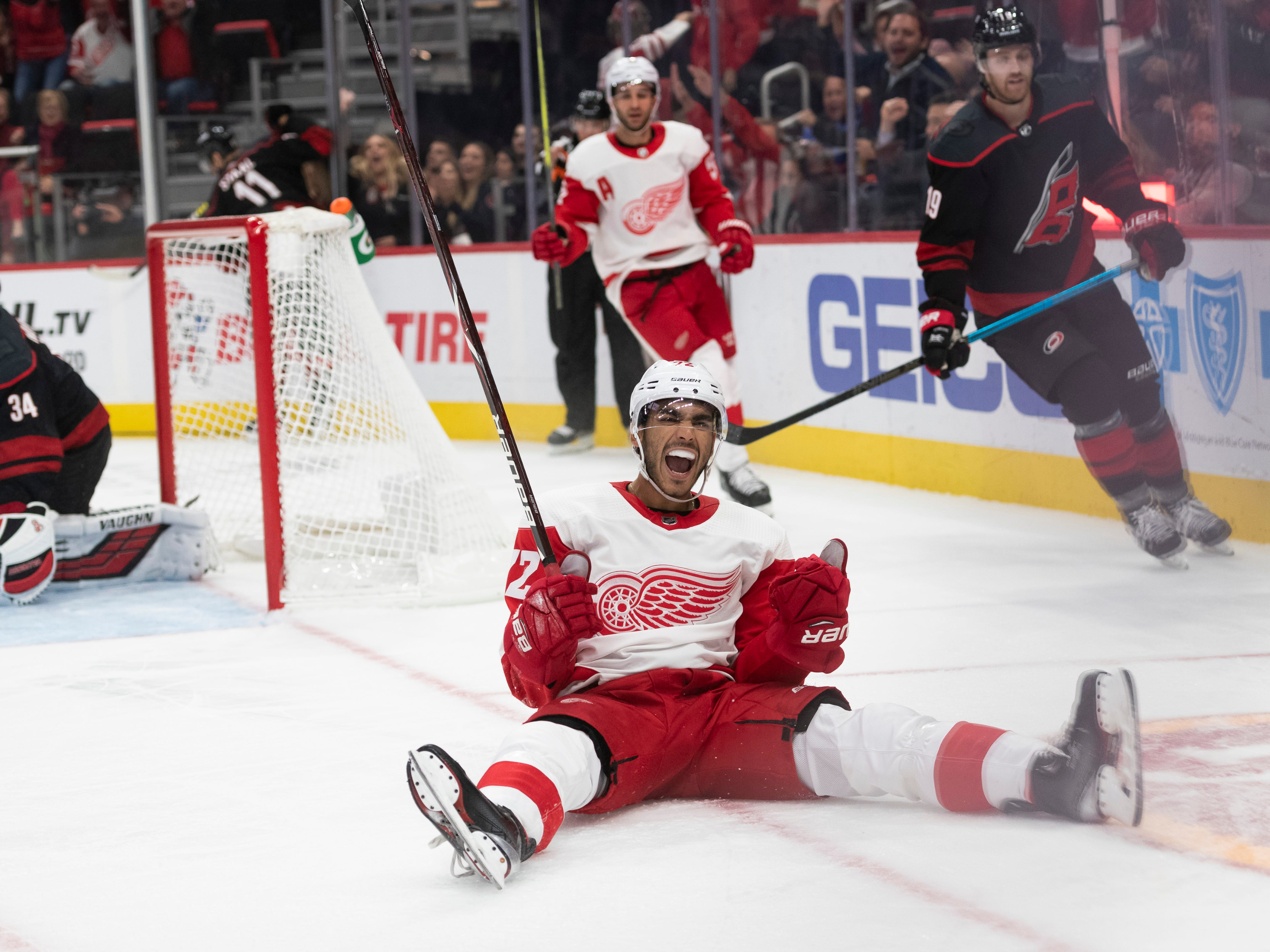 Detroit center Andreas Athanasiou celebrates after scoring on Carolina goaltender Petr Mrazek in the third period of a 3-1 loss at Little Caesars Arena, in Detroit, October 22, 2018.