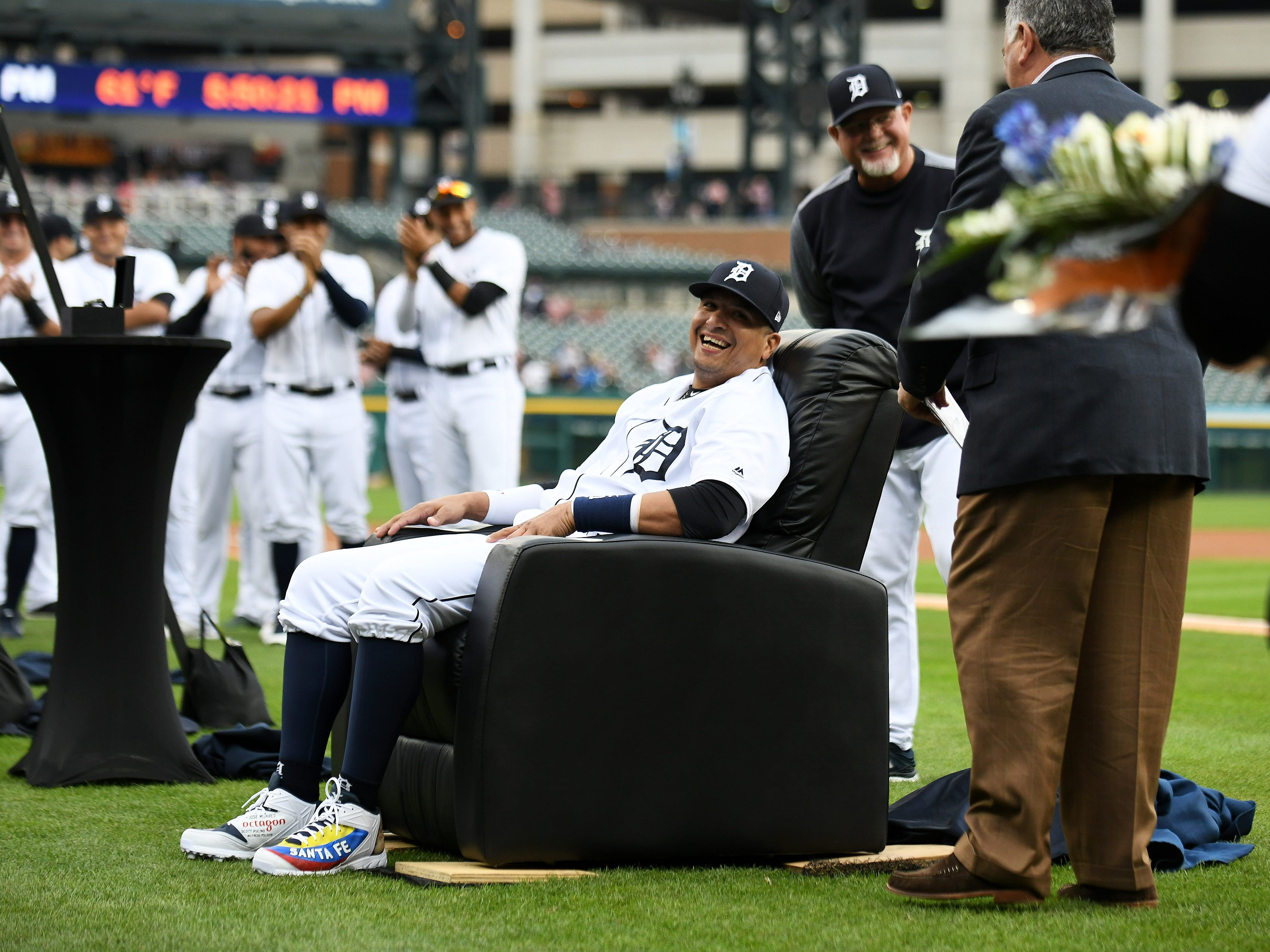 While his Tigers teammates applaud, Victor Martinez sits in his new gift recliner during a special tribute ceremony for the Tigers designated hitter and long-time team leader on Sept. 22, 2018. Martinez retired at the end of the 2018 season.