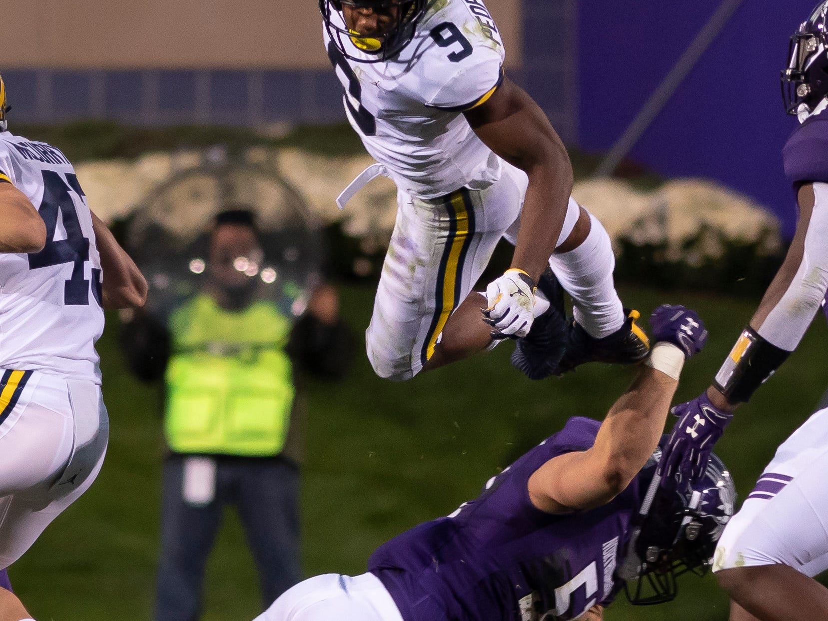 Michigan wide receiver Donovan Peoples-Jones (Cass Tech) flies over Northwestern linebacker Blake Gallagher while returning a punt in the fourth quarter at Ryan Field, in Evanston, IL., on September 29, 2018. The Wolverines rallied from a 17-0 deficit to beat the Wildcats 20-17 in their closest game of the season..