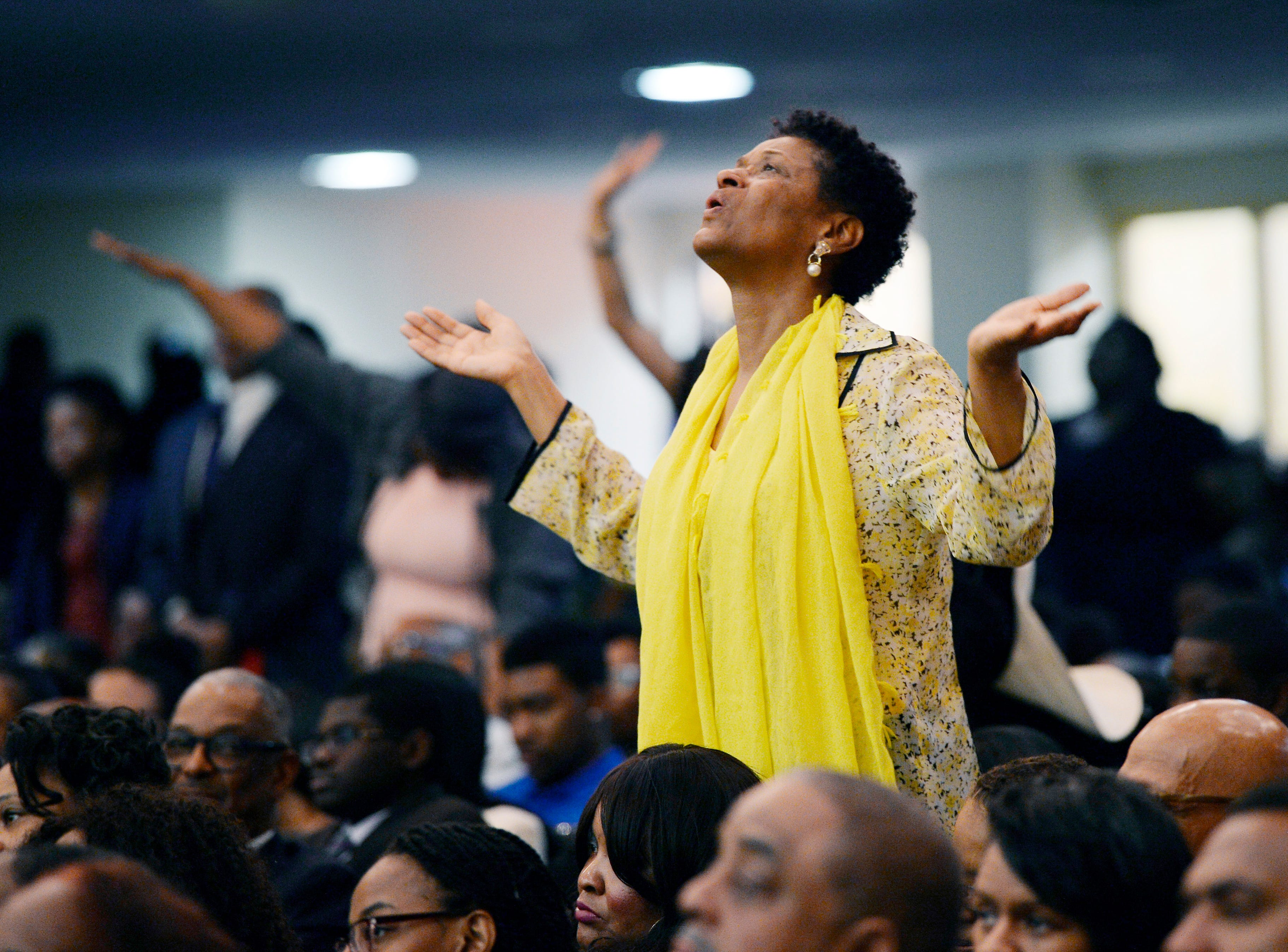 Deborah Sherrill of Detroit stands during the praise and worship section of the Easter service at Perfecting Church in Detroit on April 1, 2018.