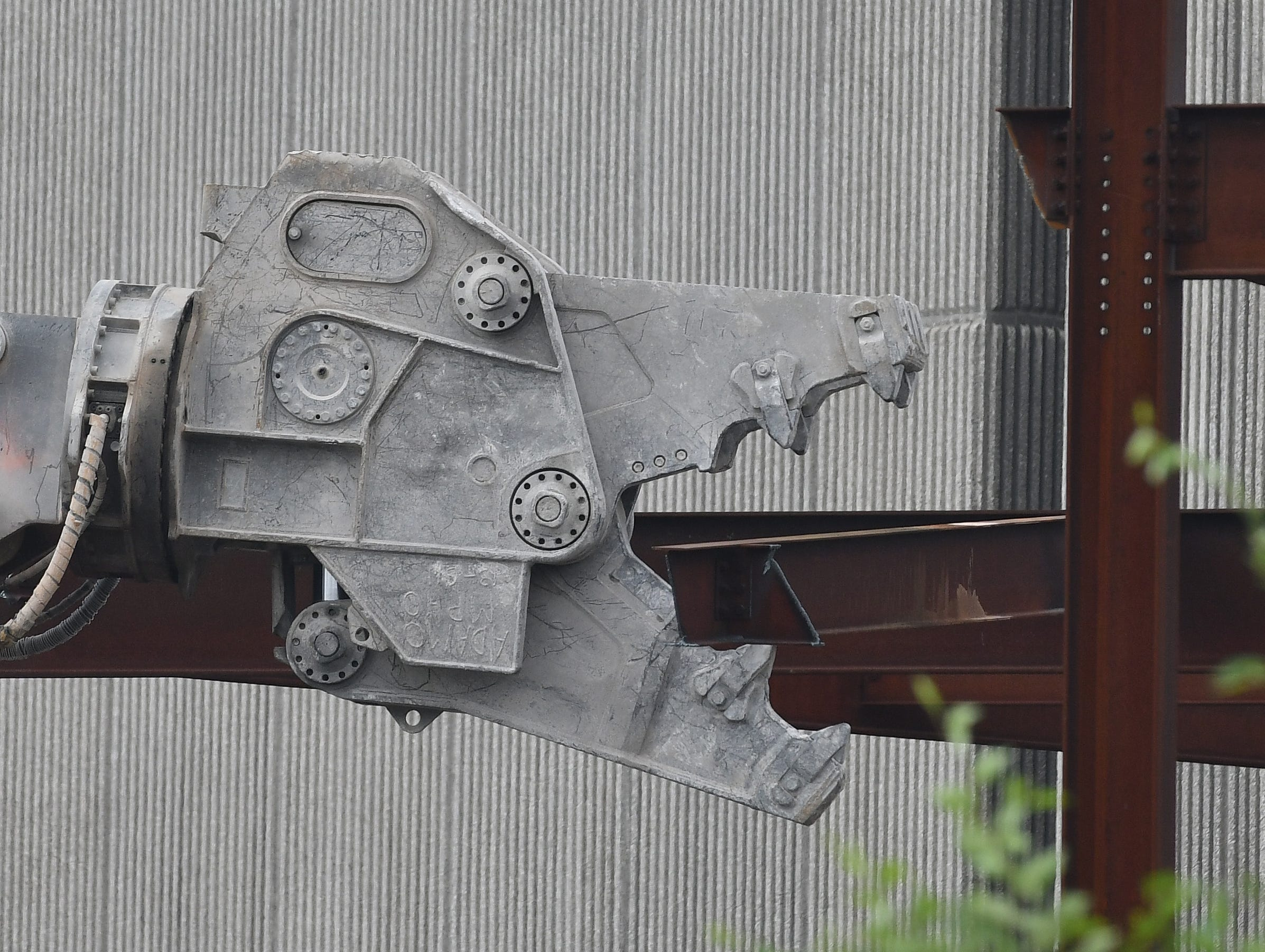Industrial-strength jaws clamp onto a steel beam for the demolition of the unfinished Wayne County Jail site along Gratiot Avenue in Detroit on July 25, 2018.