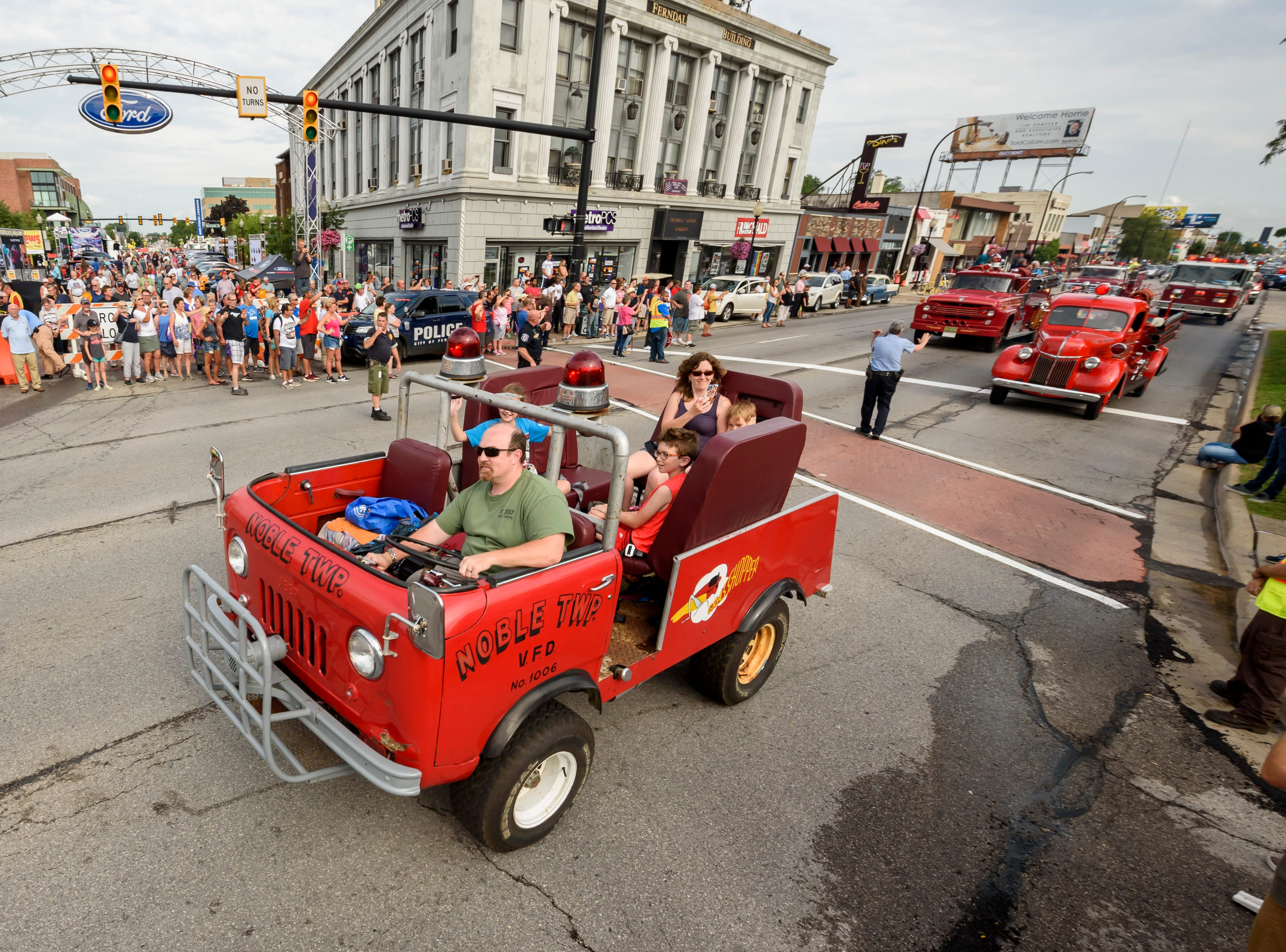 Matt Sasina, of Farmigton Hills, drives his 1960 Jeep brush truck, which was used by the Noble Twp. fire department, in the 18th Annual Ferndale Emergency Vehicle Show, August 17, 2018. Dozens of emergency vehicles from across the decades participated in the parade that ran for two miles of Woodward Ave.