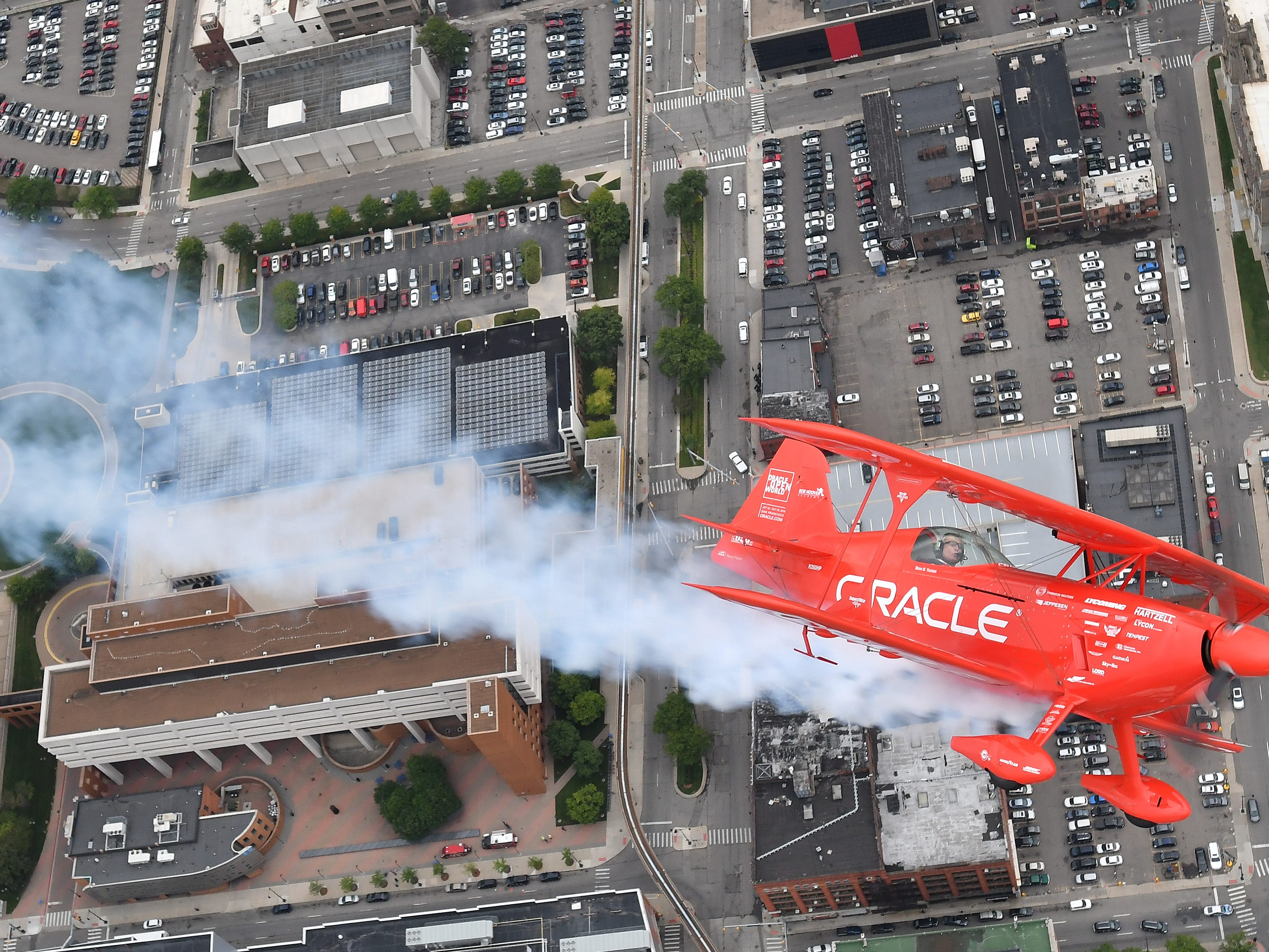 "Legendary pilot Sean D. Tucker flies his Oracle Challenger III over Detroit on August 21, 2018.  His plane was going to be placed in the Smithsonian National Air and Space Museum. ""It could not be a better topping on the cake for the most rewarding career a guy could have,"" Tucker said."