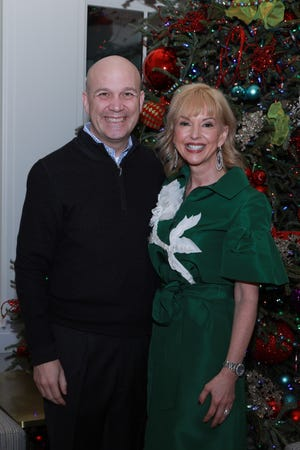 Chris Granger, group president, sports and entertainment, of Ilitch Holdings, and his wife, Jennifer Granger, host a festive holiday party.