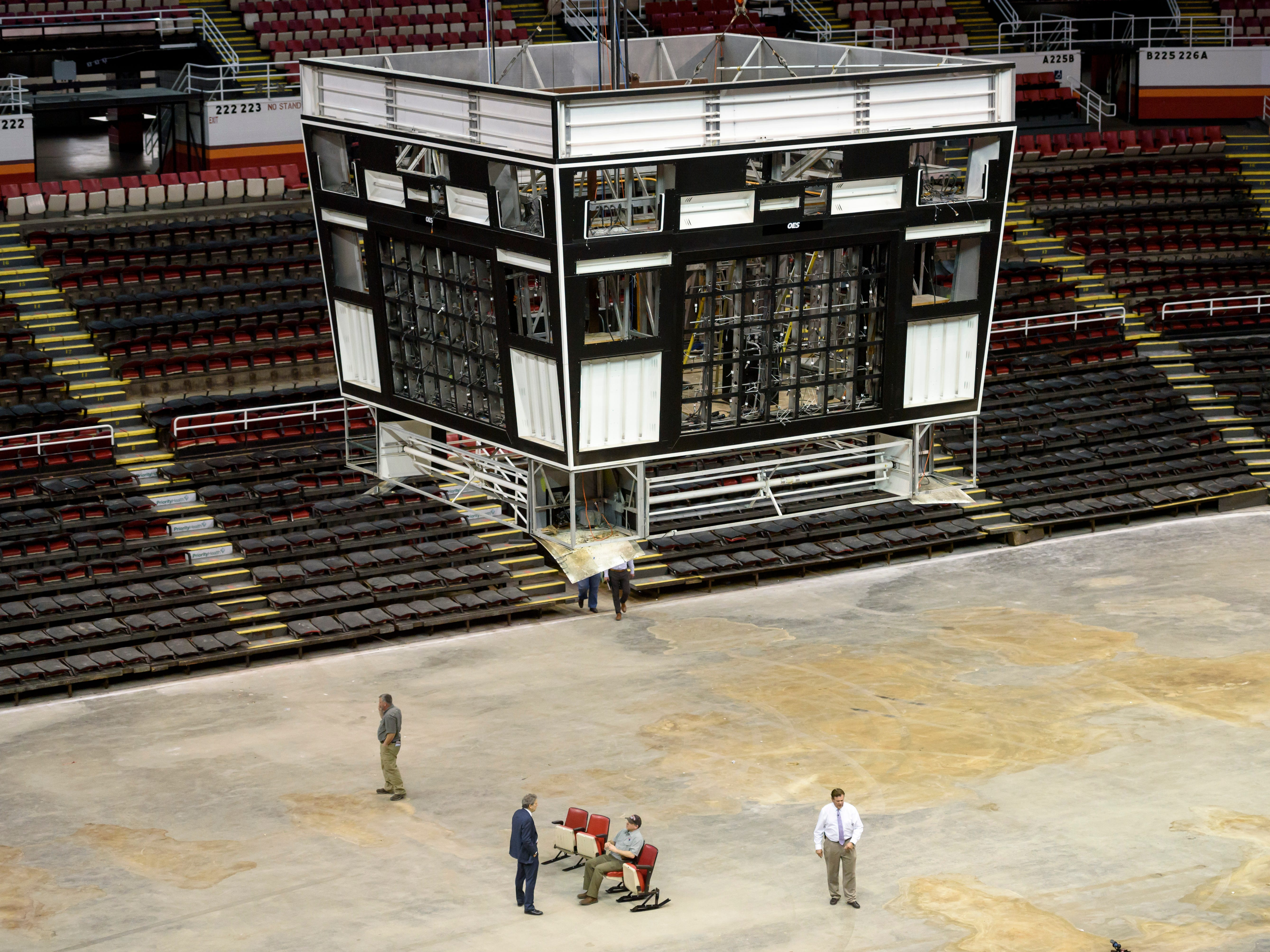 Workers at Joe Louis Arena in Detroit disconnect the seats from the concrete on May 1, 2018.  The sale of about 14,000 seats brought in $1.4 million for the city of Detroit. The building likely will be razed in 2019.