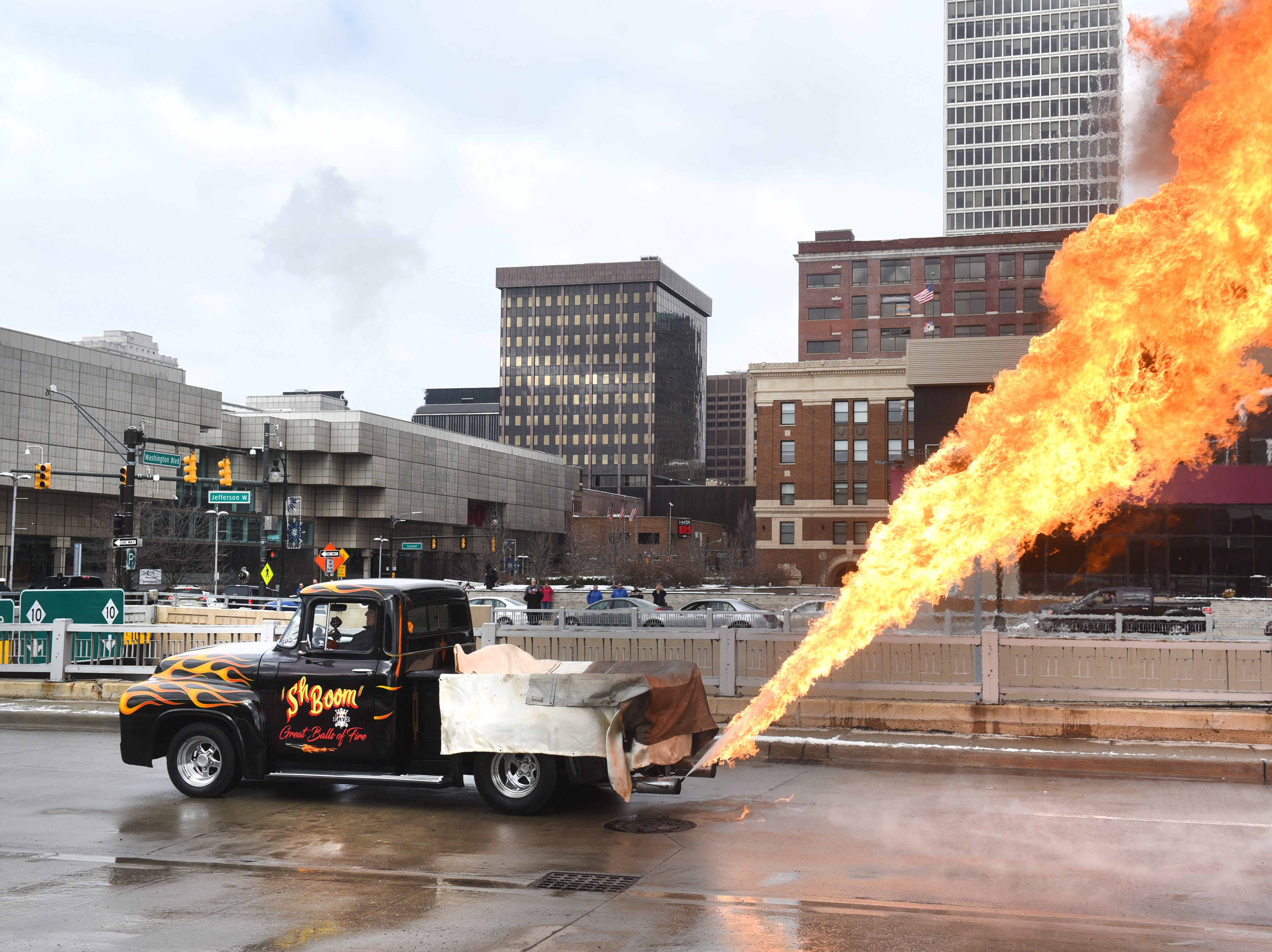 Flames shoot out from the famous Sh'Boom truck for the opening of the Autorama custom car show at Cobo Center in Detroit on Friday May 2, 2018.