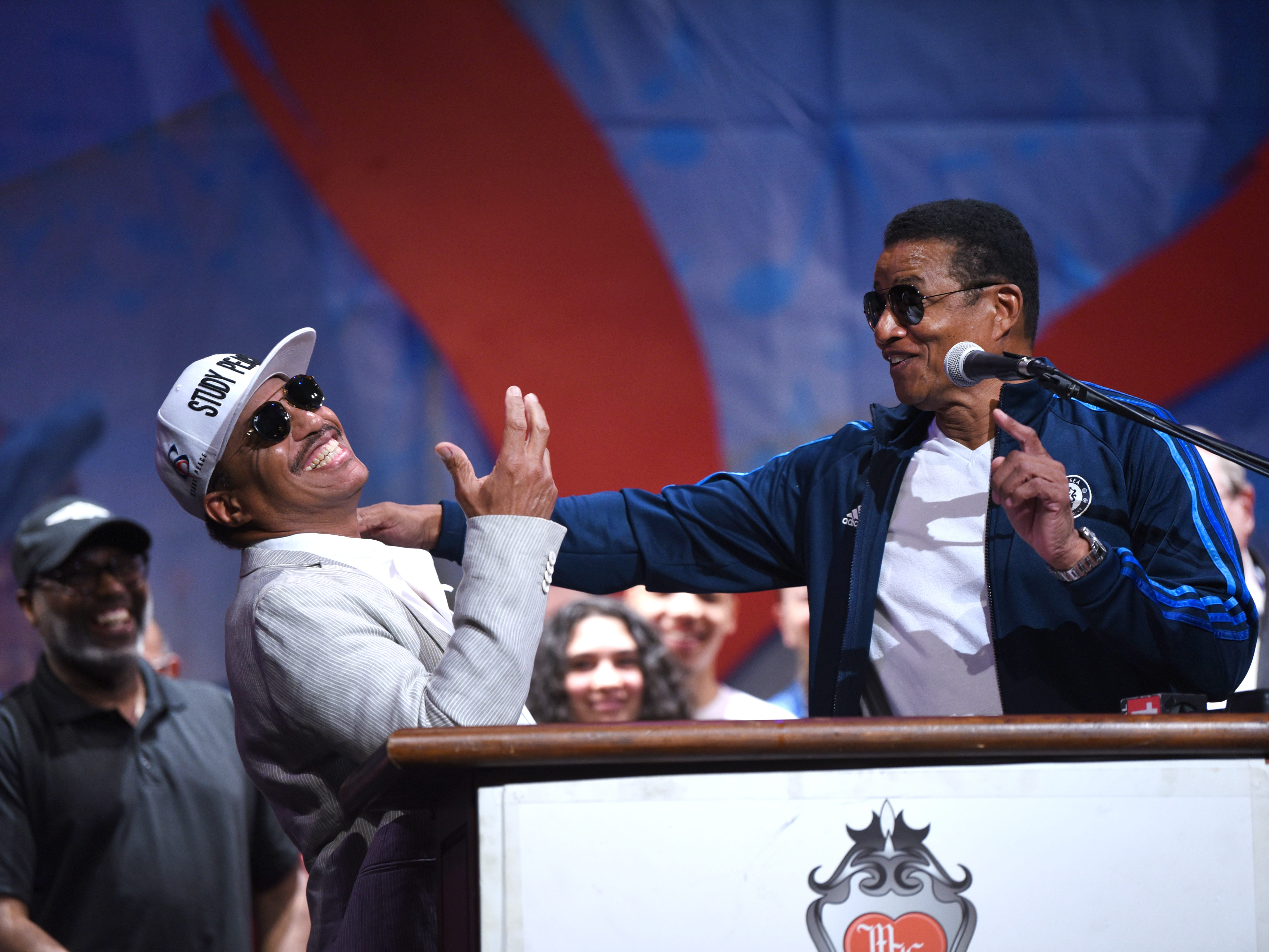 Marlon Jackson, left,  and his brother Jackie have fun as they announce their performance at the upcoming Detroit Music Weekend during a press conference at the Music Hall in Detroit on May 17, 2018.